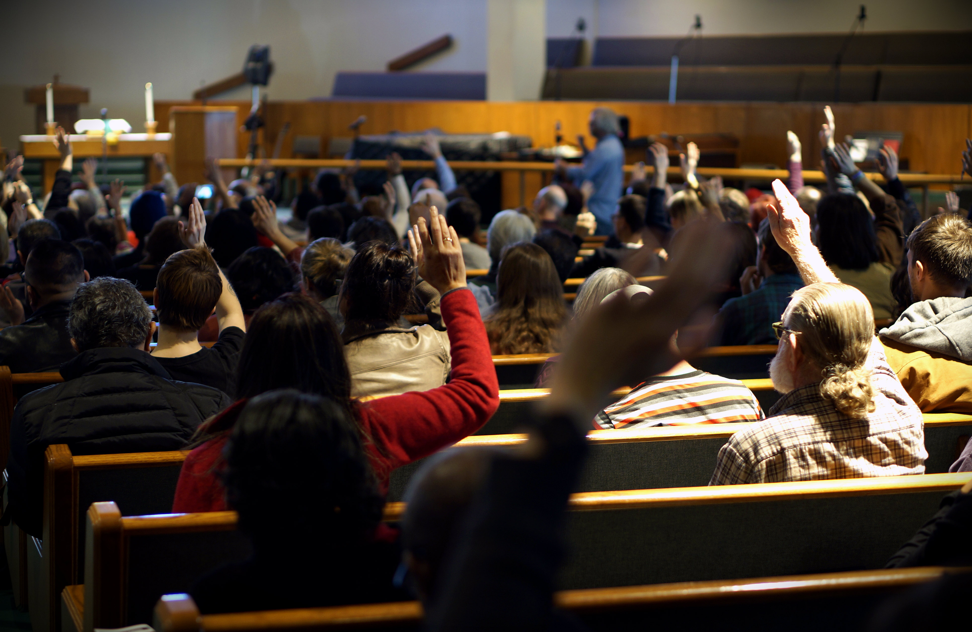 Photo: Denver Gentrification Summit_Raising Hands