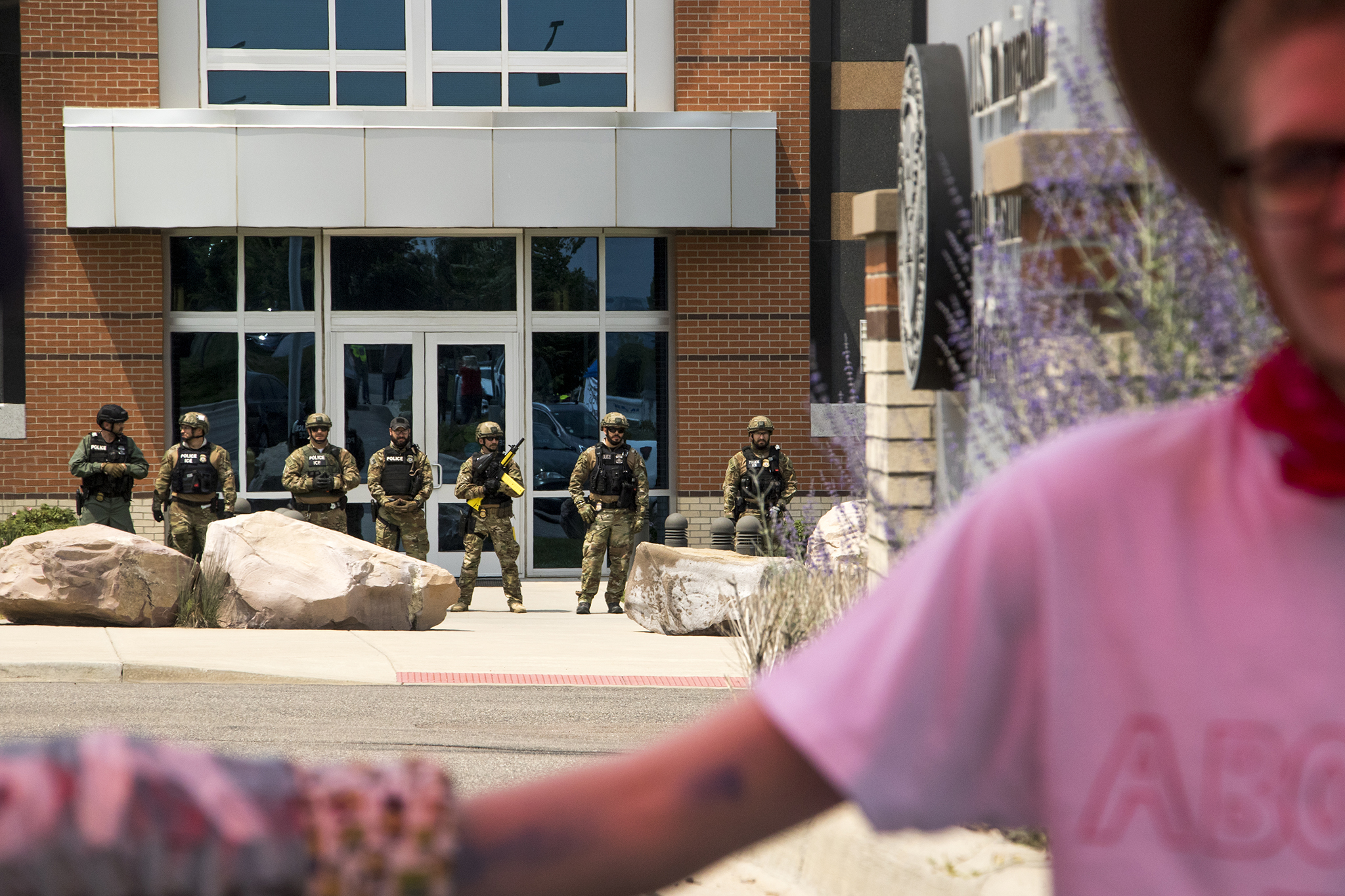 <p>U.S. Immigration and Customs Enforcement officers emerged equipped with military-style gear as protesters blockaded their headquarters in Centennial, Aug. 2, 2018. </p>