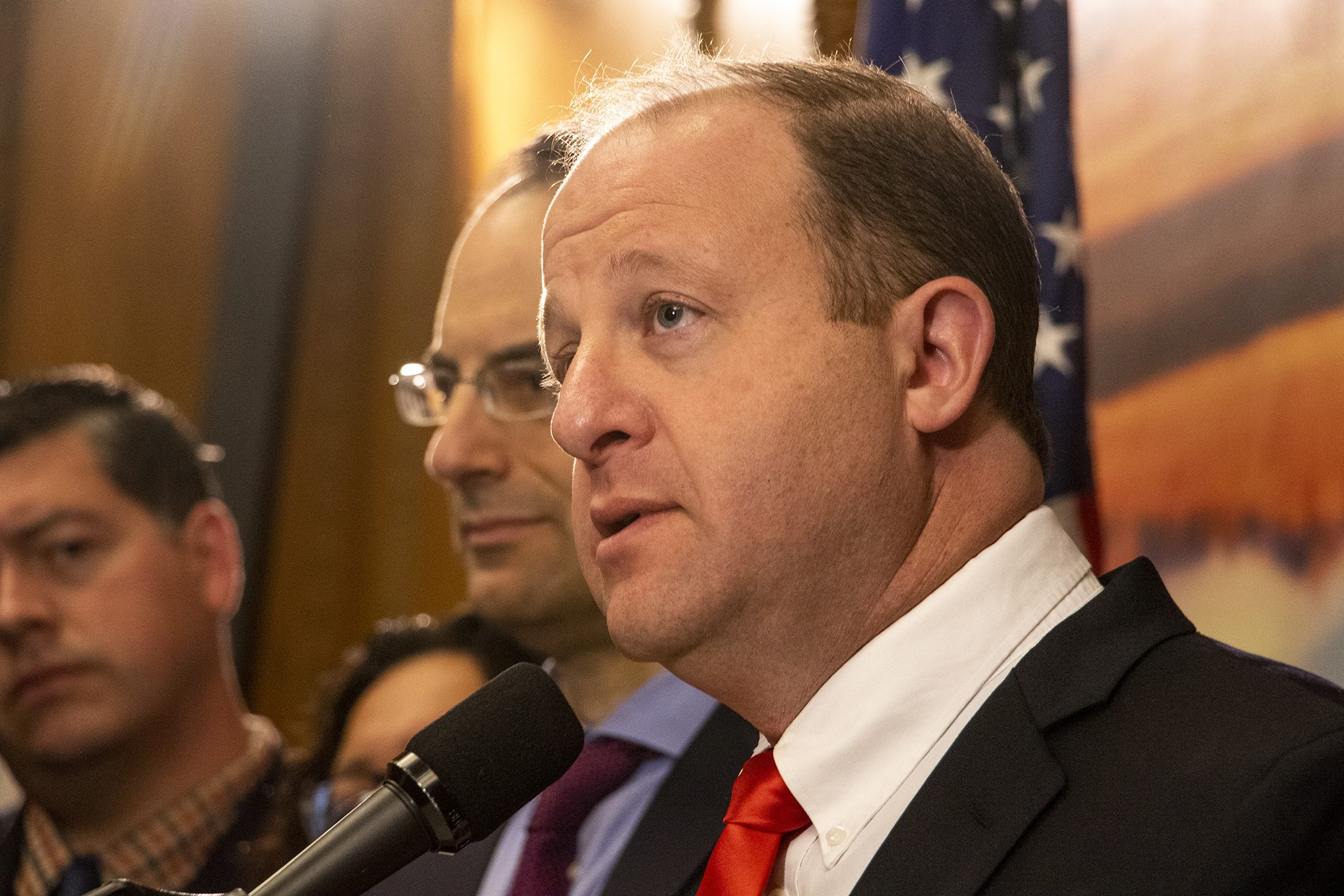 Gov. Jared Polis announces a lawsuit against the federal Justice Department for withholding grant money bound for state police departments, March 12, 2019.