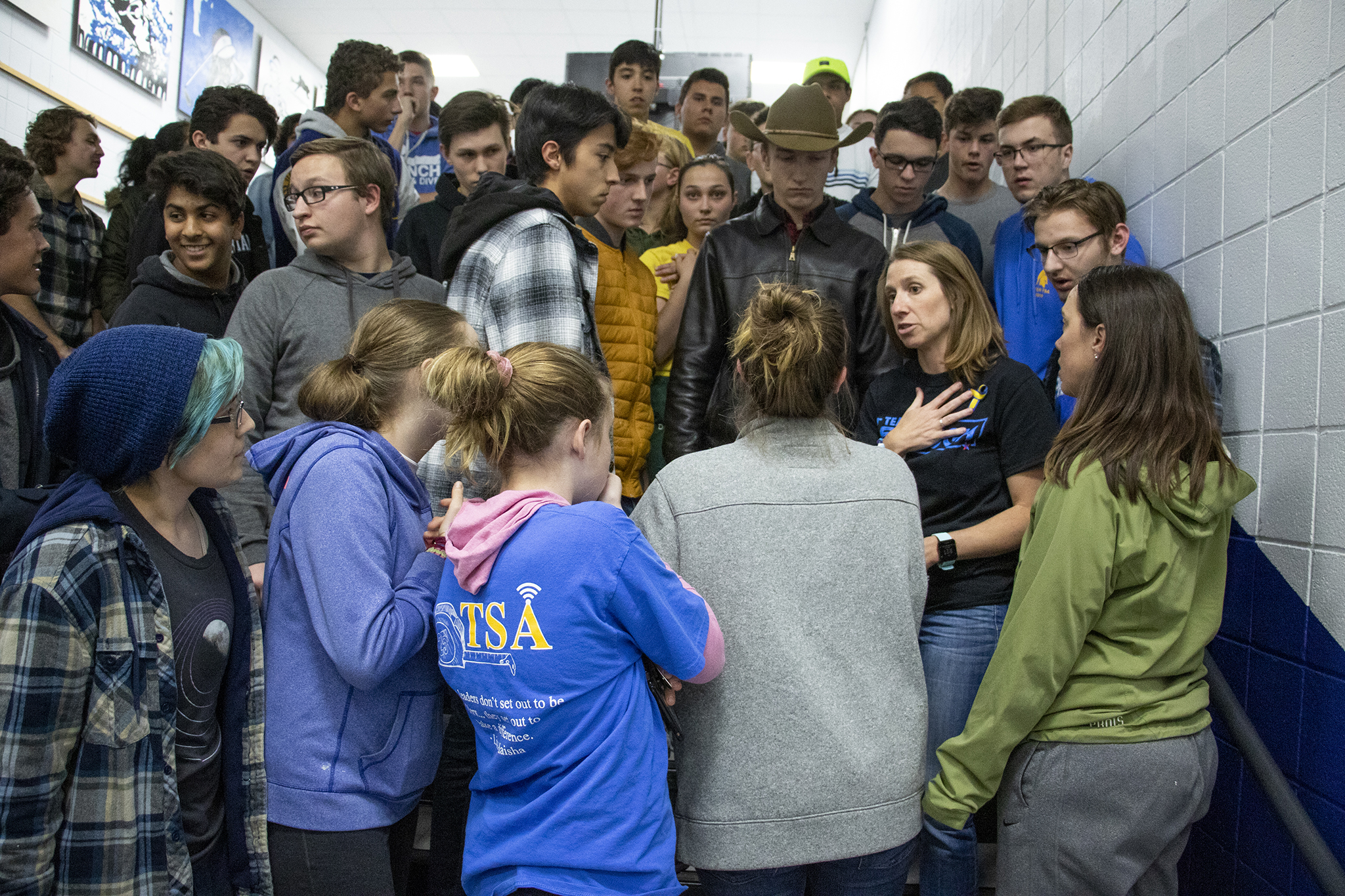 Photo: STEM School Highlands Ranch students meet in the hallway during a vigil at Highlands Ranch High School
