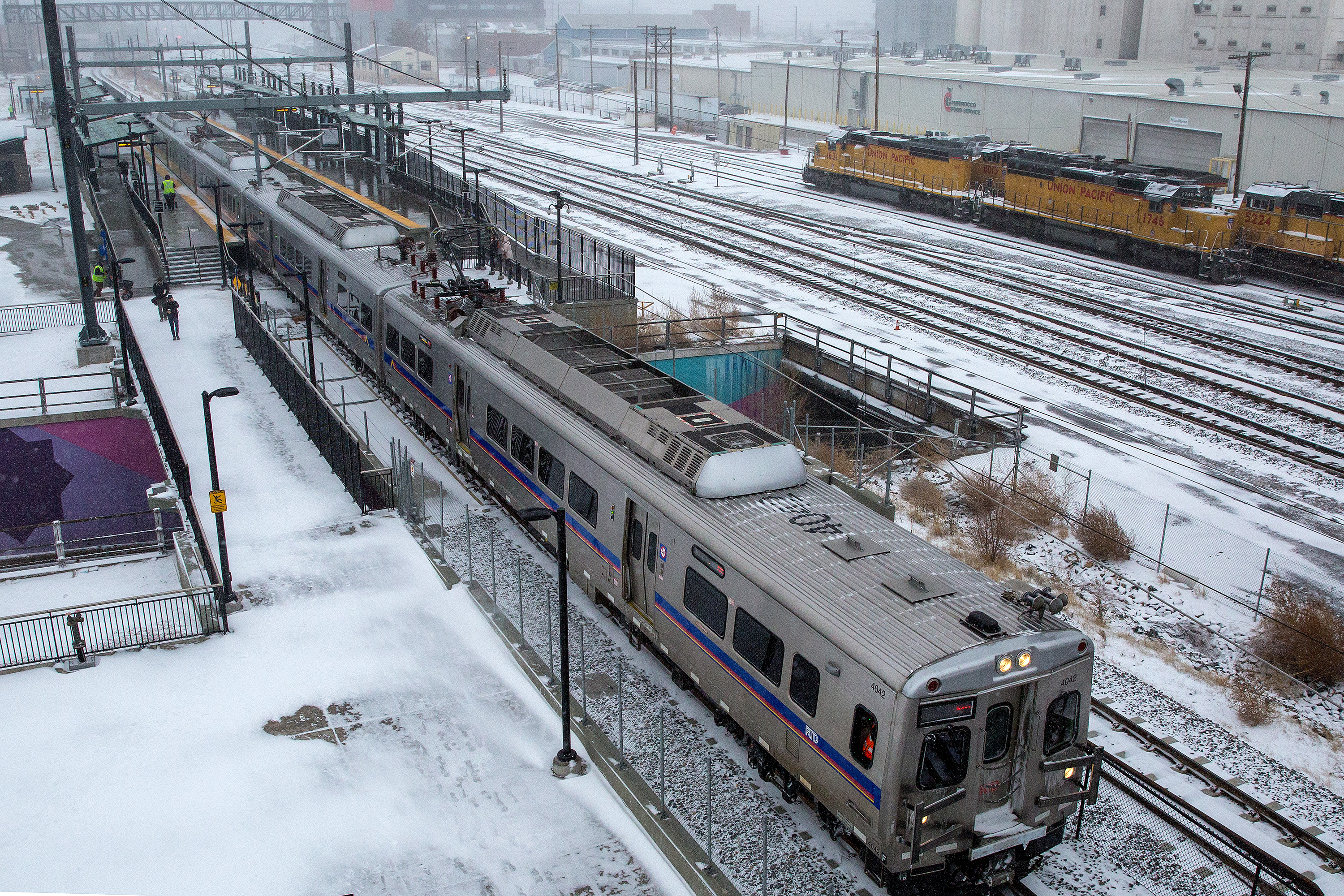 Photo: A Line RTD Commuter Rail 38th Street Station Snow 2 HV 20190124