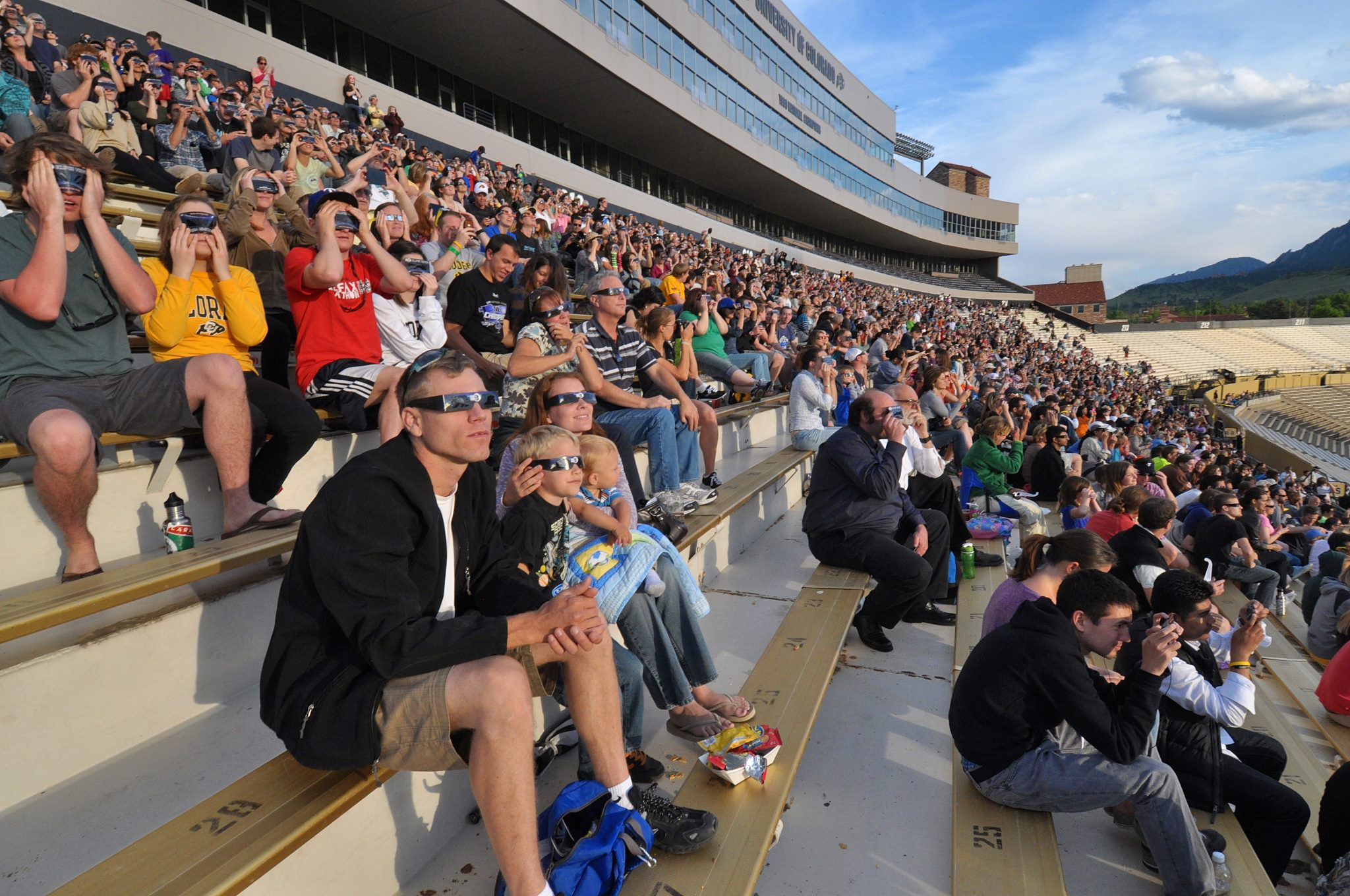 Photo: Eclipse glasses watching at Folsom Field