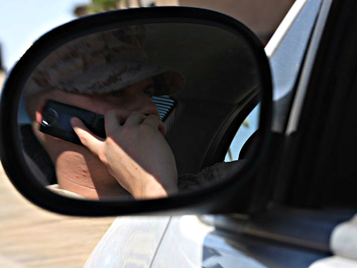 Photo: On cell phone while driving