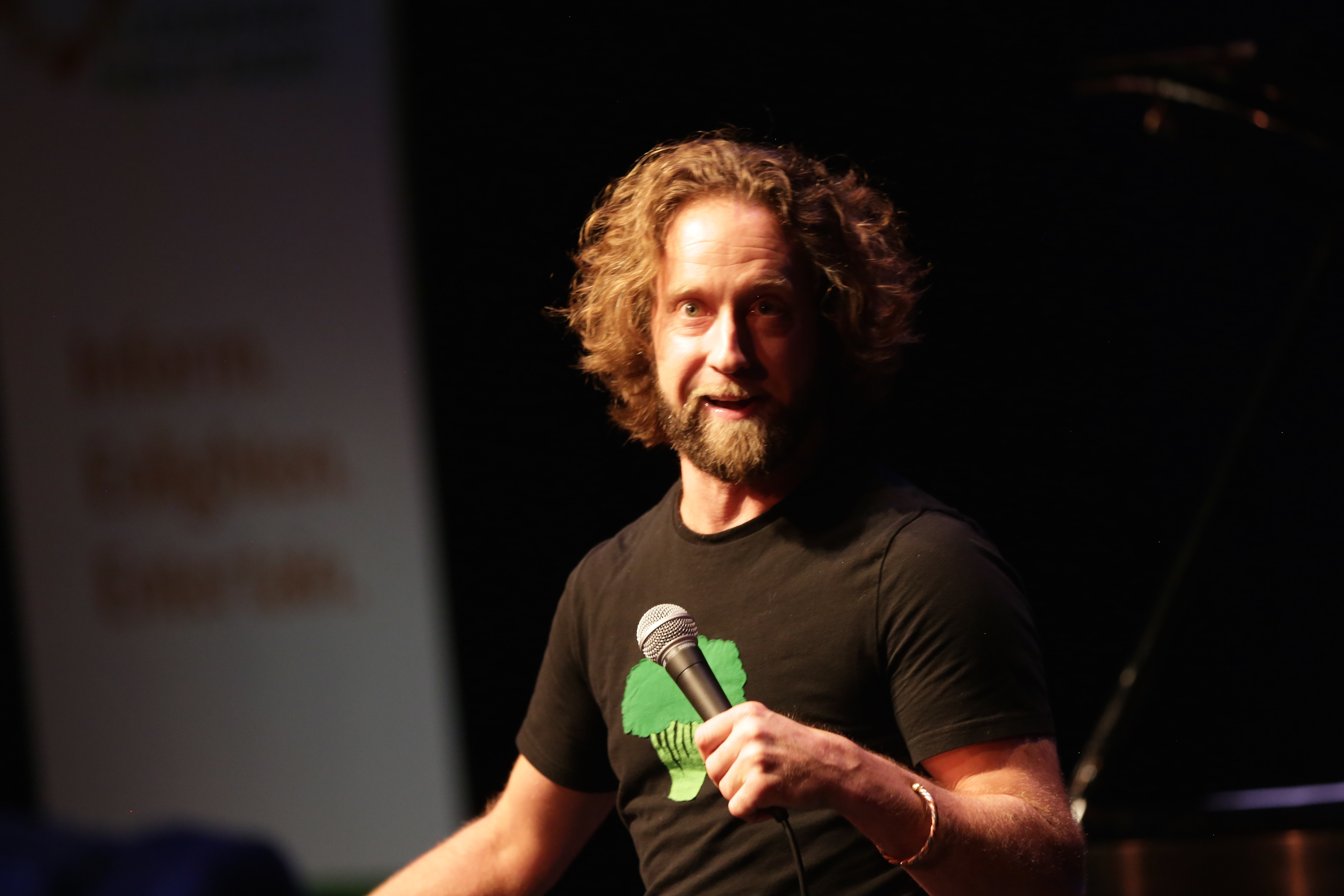 <p>Denver comedian Josh Blue performs for a packed house during the 2017 Colorado Matters Holiday Extravaganza.</p>