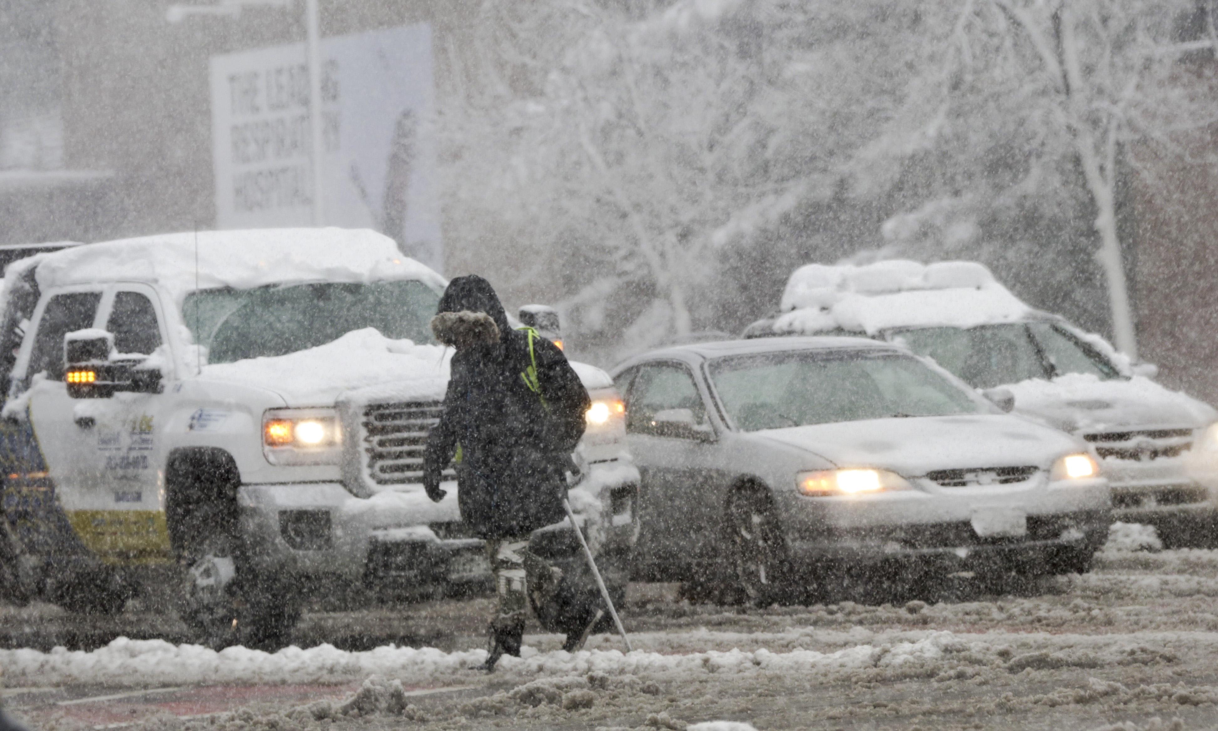 Photo: Pedestrian walks on snowy March morning (HV)