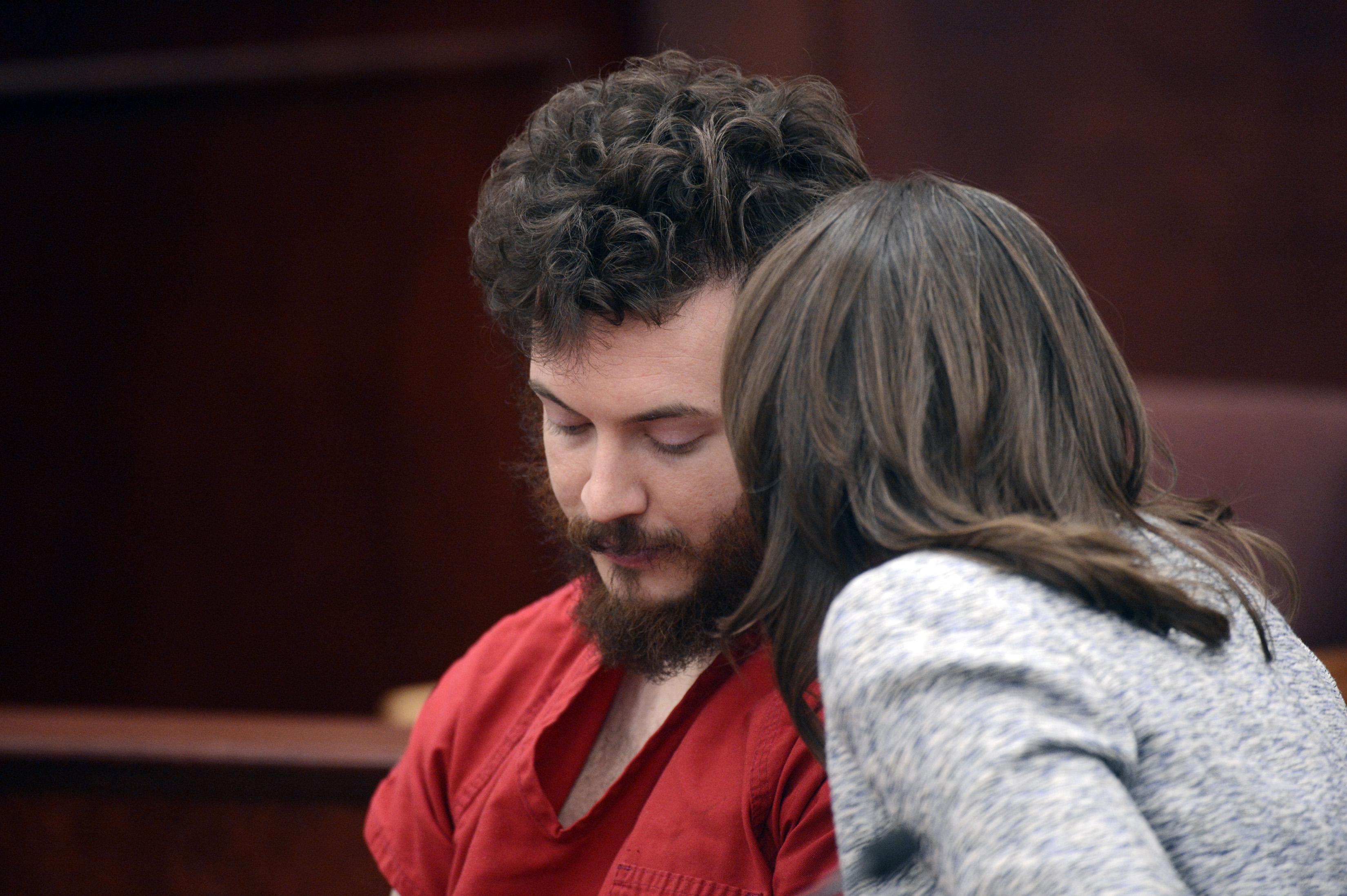 Photo: James Holmes listens to his defense attorney Tamara Brady in court