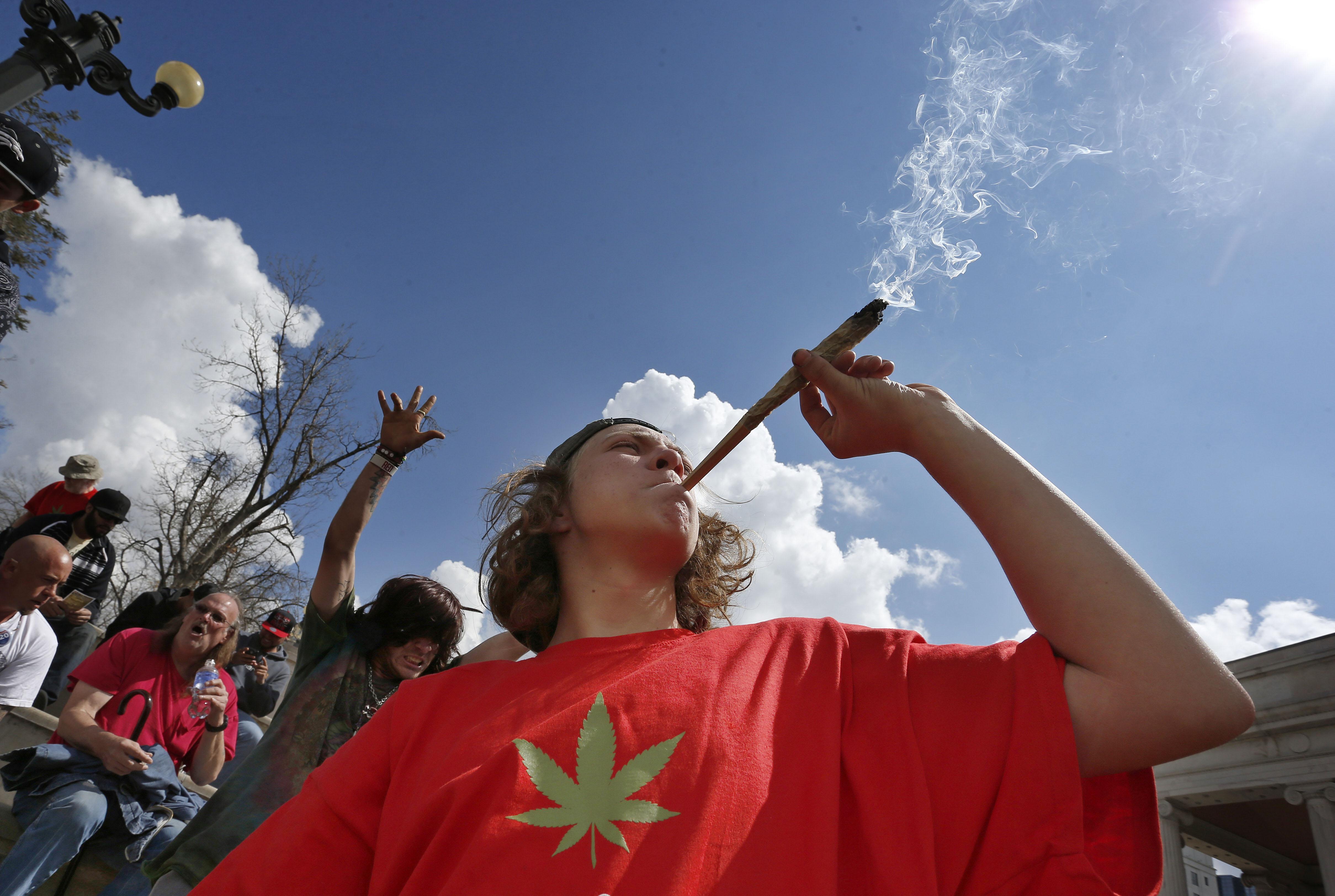 Photo: Smoking marijuana at 4/20 festival in Denver