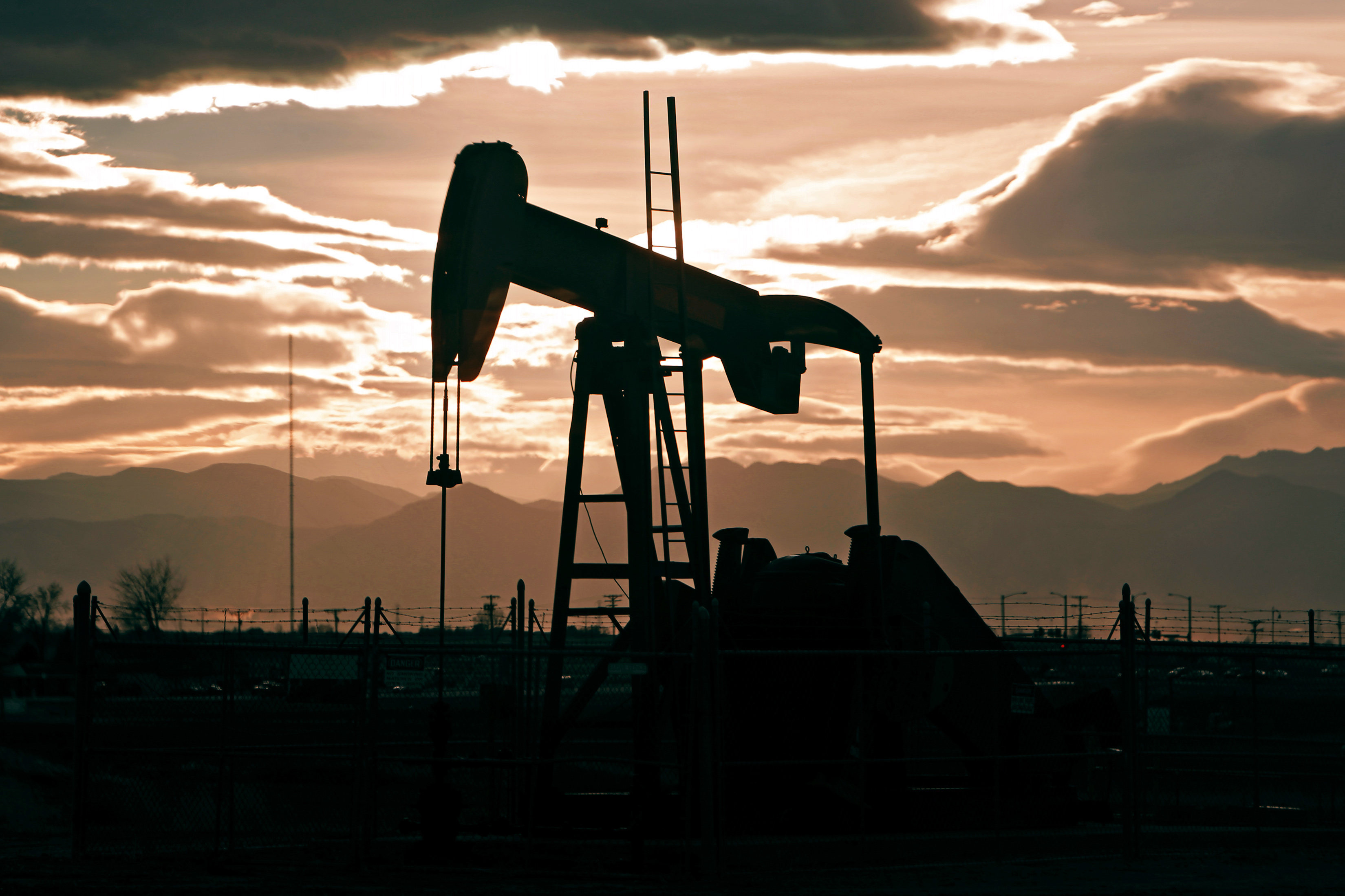 Photo: Oil drilling, pump jack, Colorado, sunset