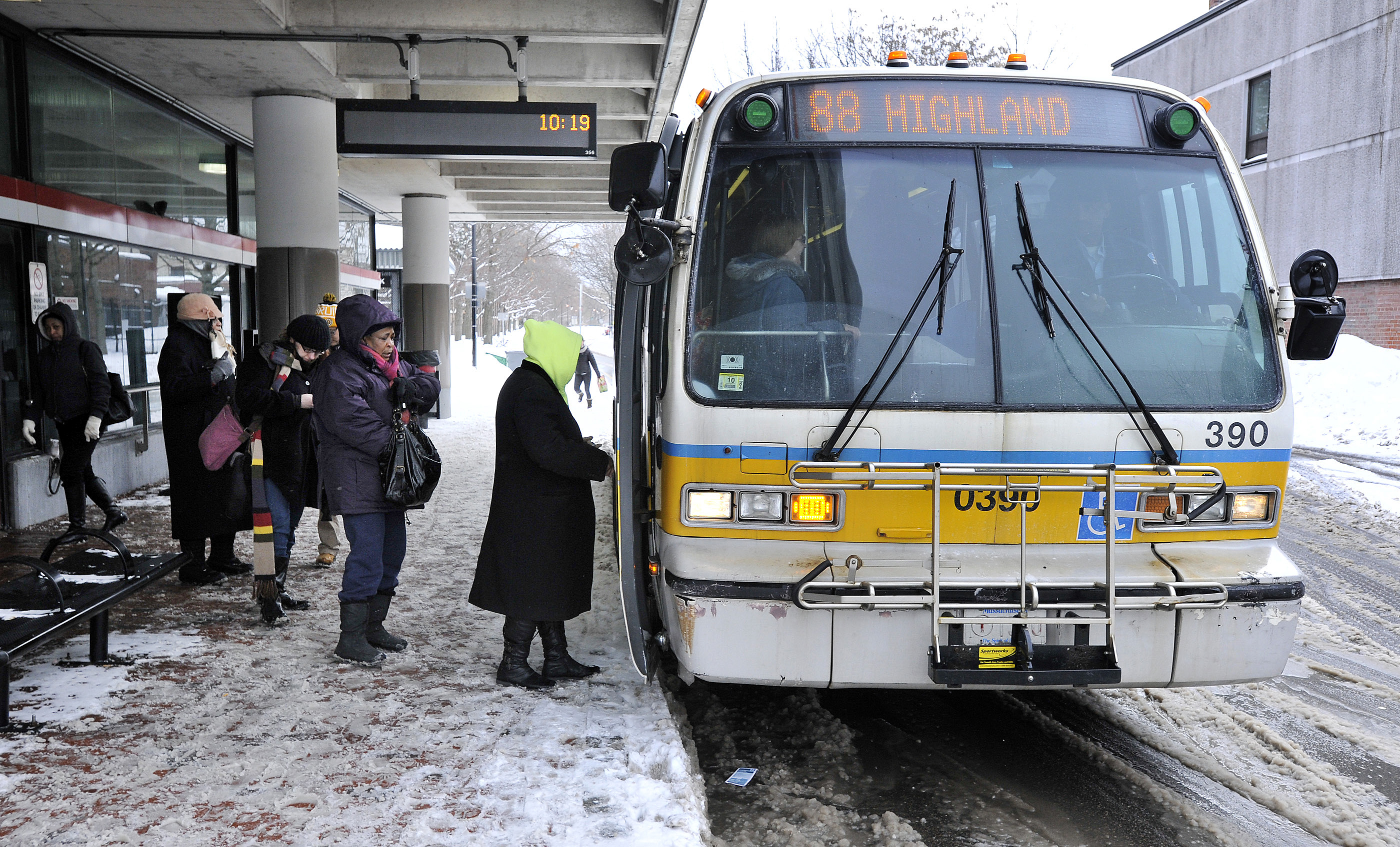 Photo: Bus in snowy Massachusetts (AP Photo)