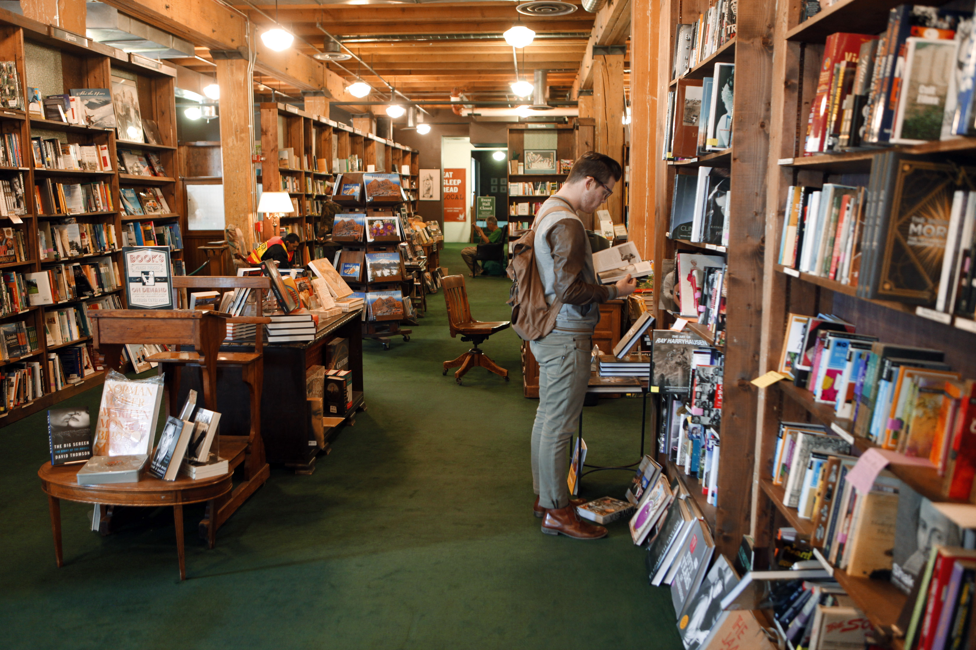 Photo: Tattered Cover, downtown Denver, book stacks and customers