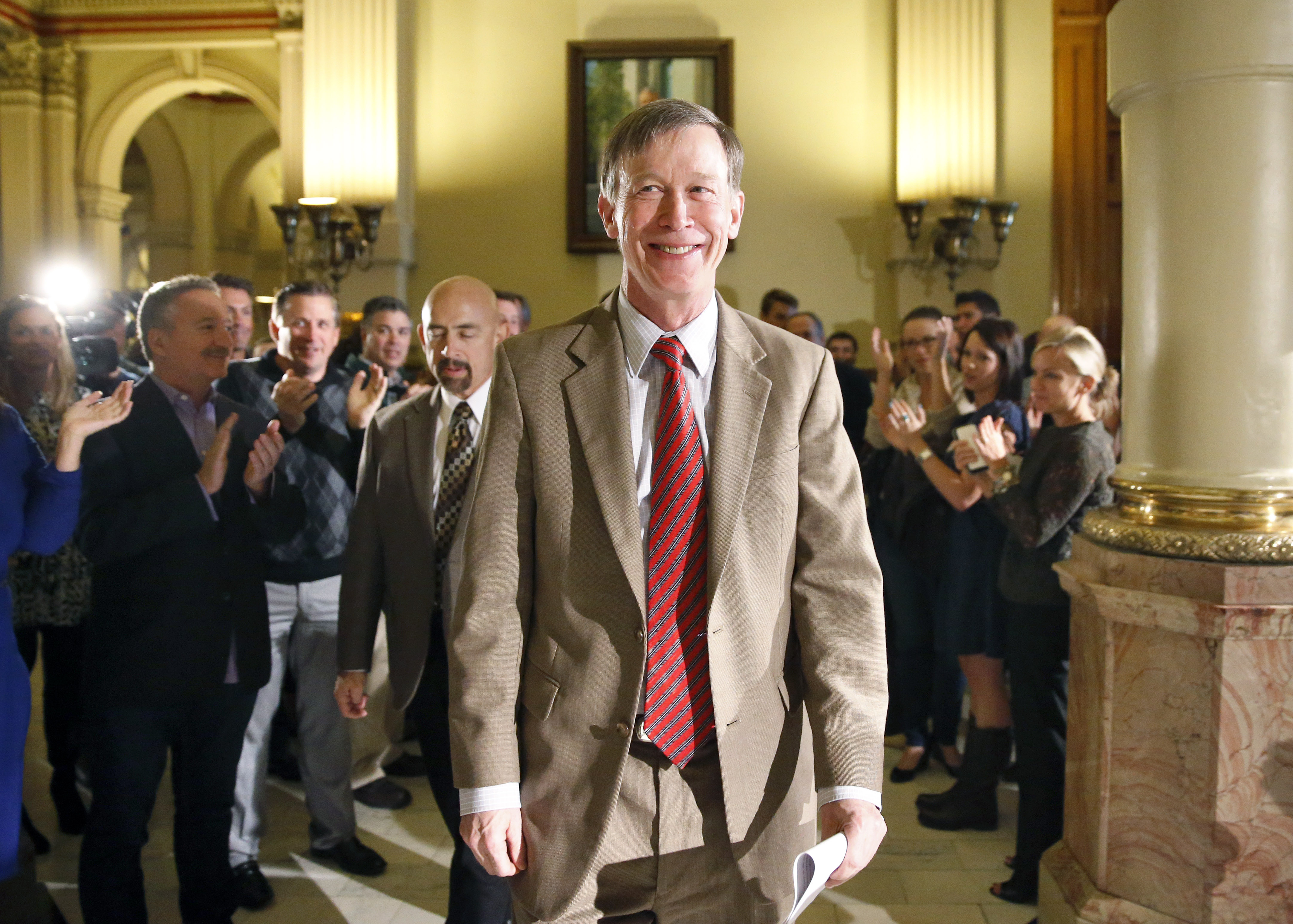 Photo: Colorado Gov. John Hickenlooper gives victory speech (AP Photo)