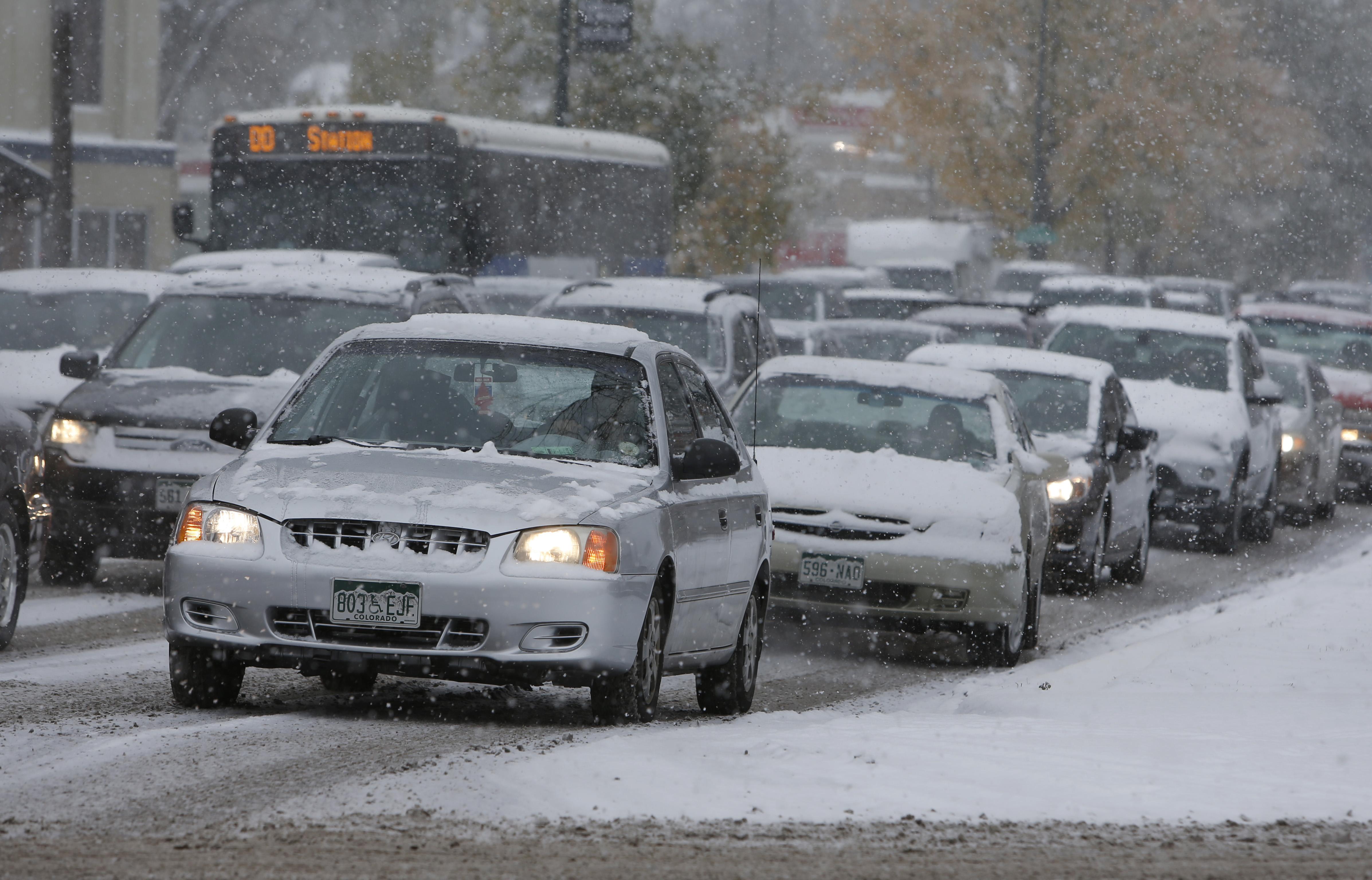 Photo: Snowy traffic along Speer (AP Photo)