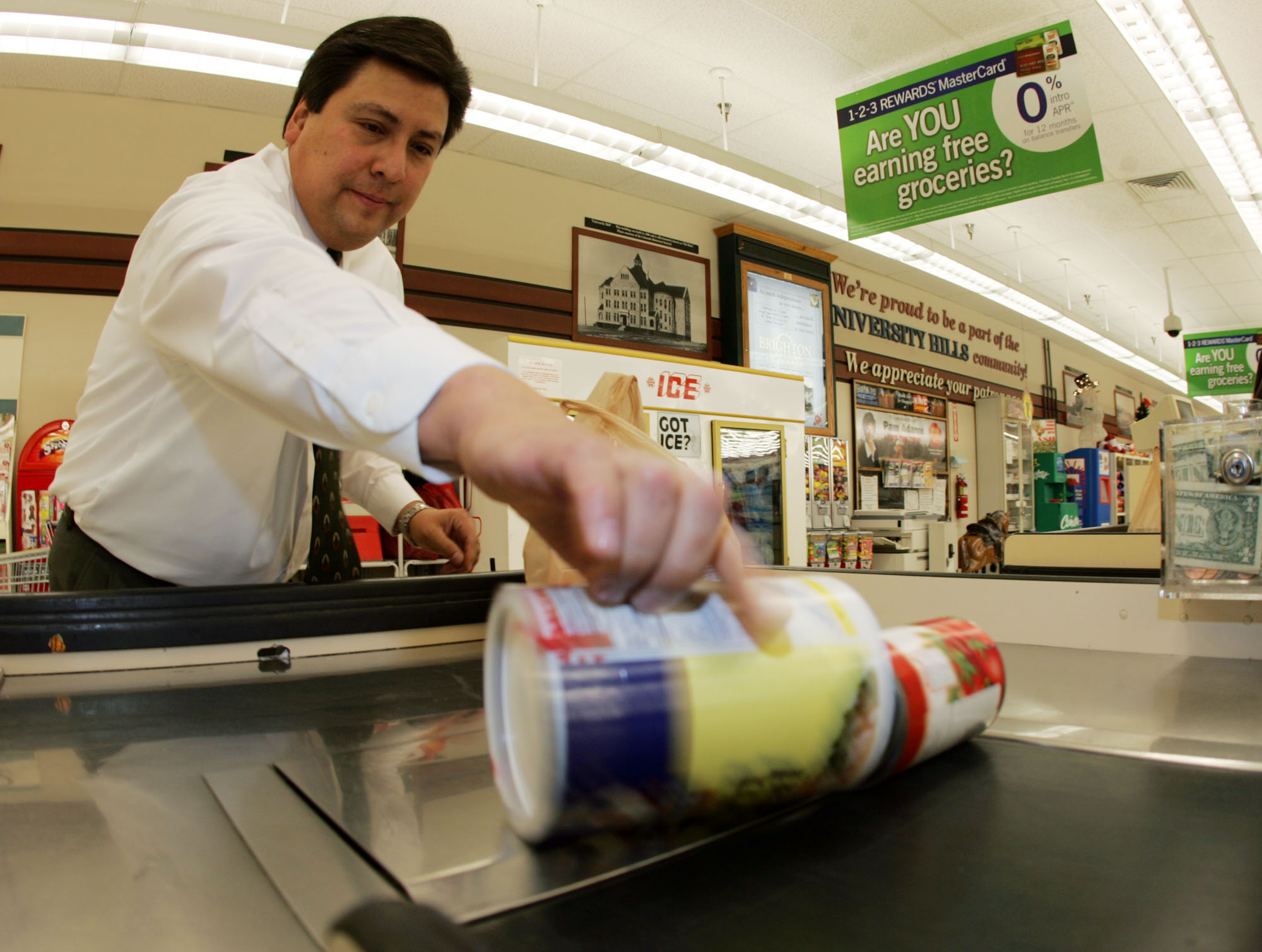 Photo: Bagging groceries at King Soopers (AP Photo)