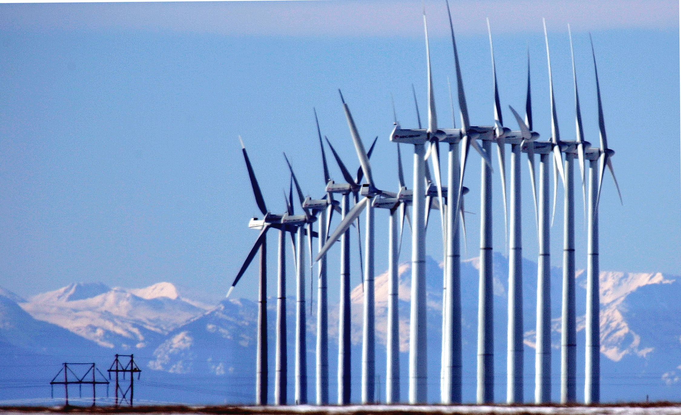 Photo: Wind Turbines With Rocky Mountain Backdrop