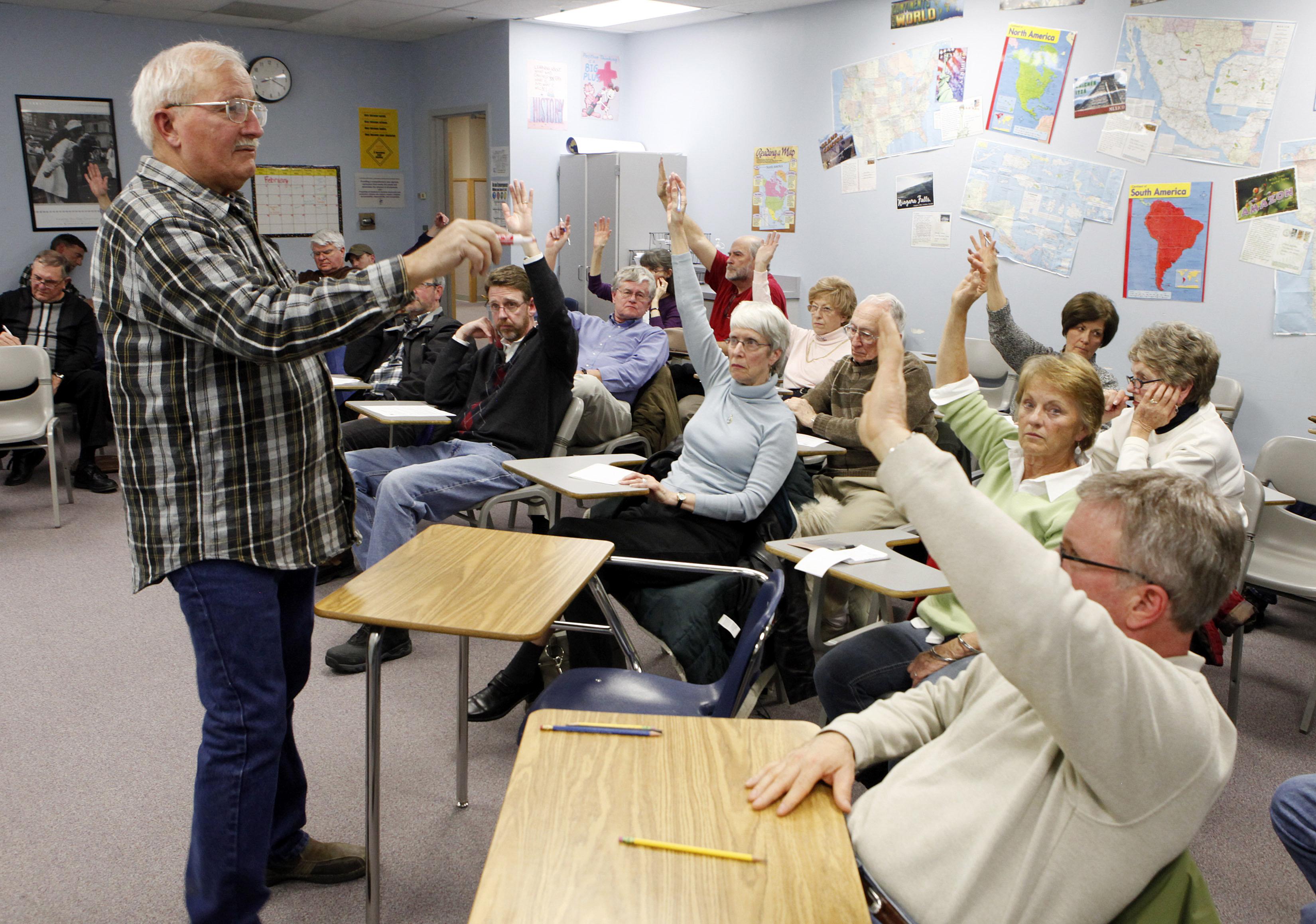 Photo: 2012 GOP caucus (AP Photo)