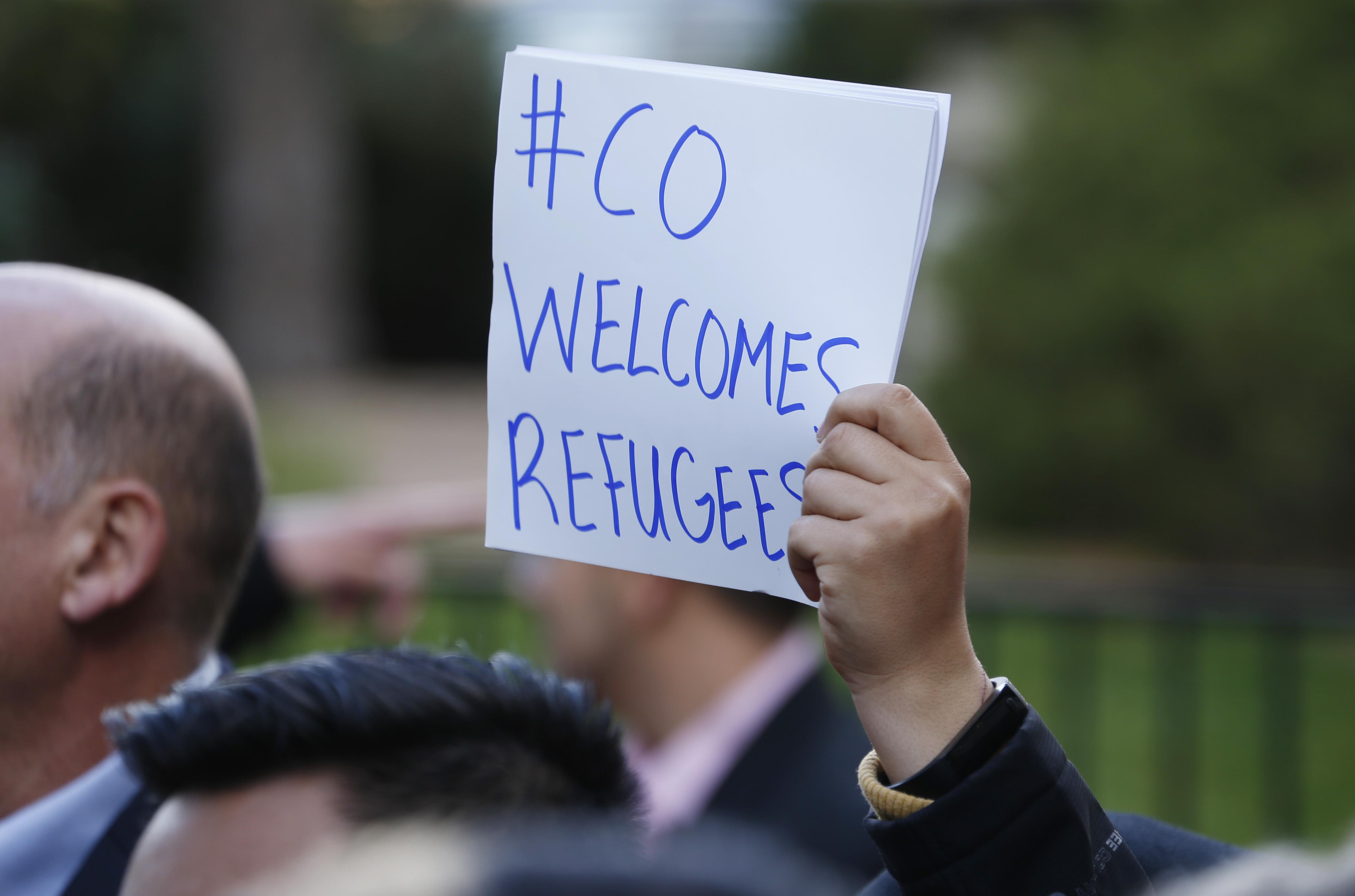 Photo: Refugee rally Denver Nov. 2015 (AP Photo)