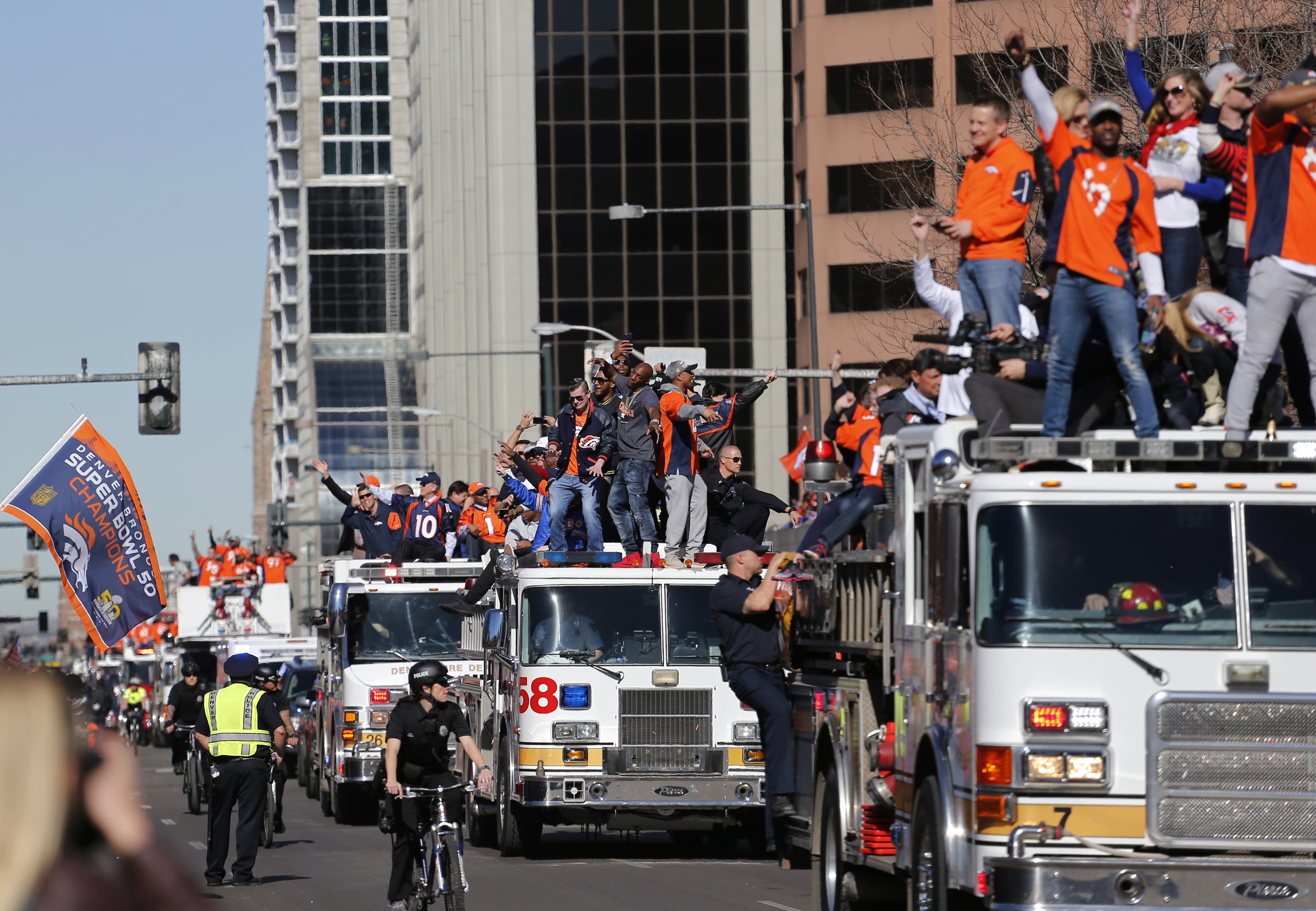 Photo: Broncos parade 11 | Team on fire engines
