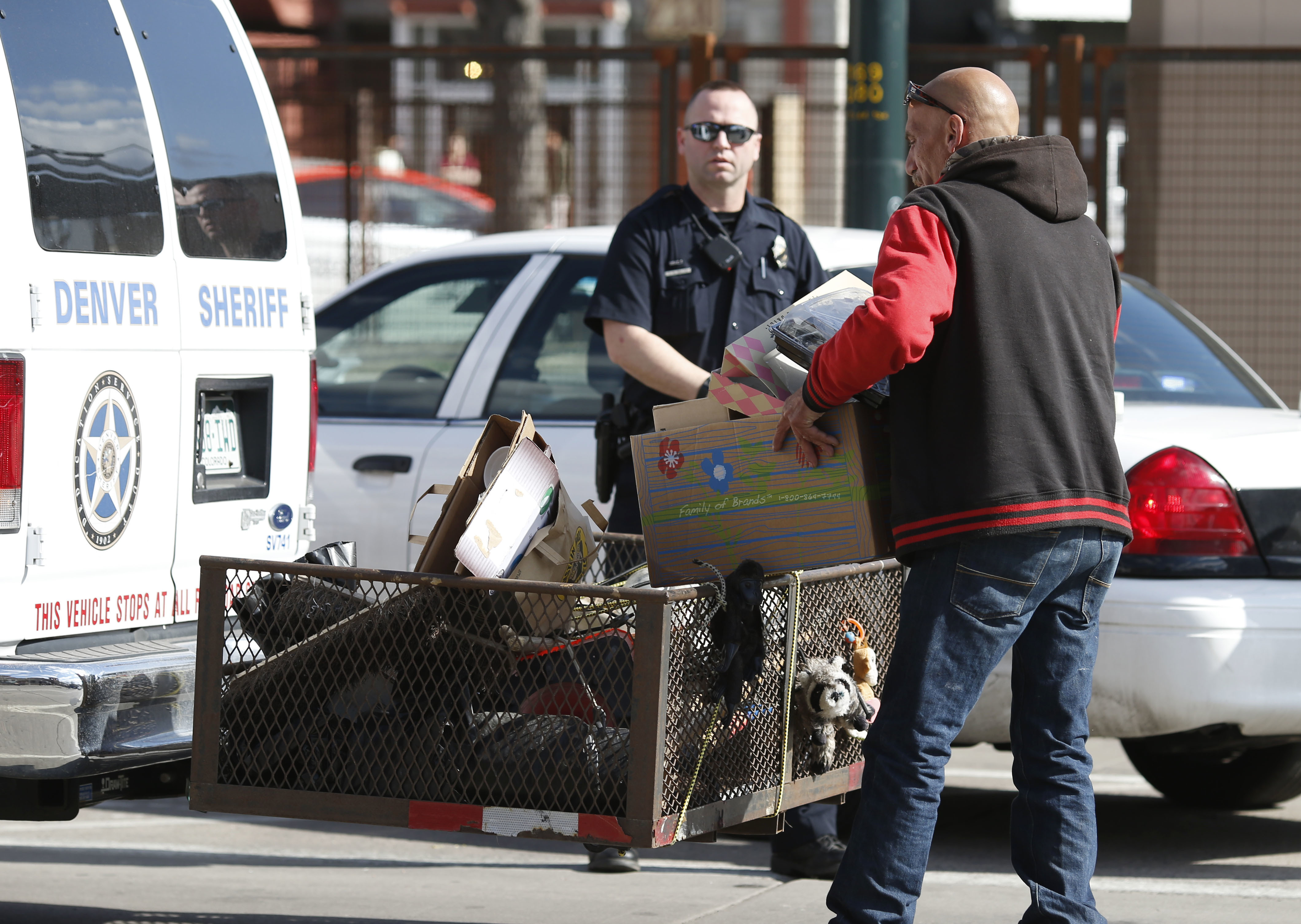 Photo: Homeless sweep downtown Denver March 2016 (AP Photo)