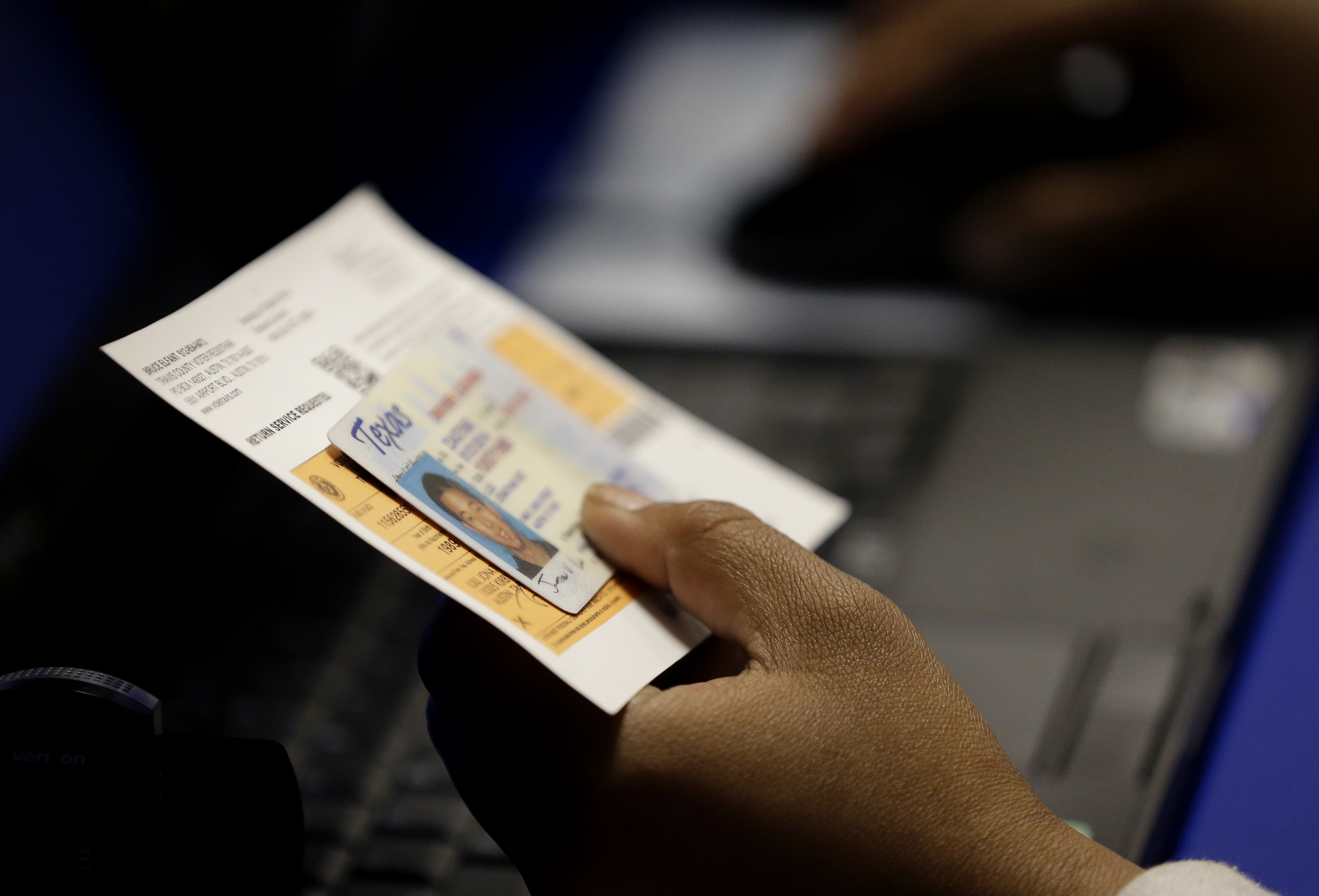 Photo: Voter ID in Texas (AP Photo)
