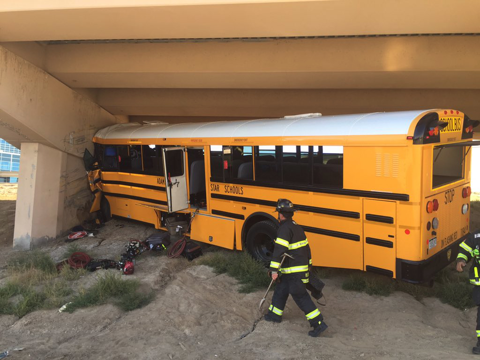 Photo: DIA bus crash (AP Photo)