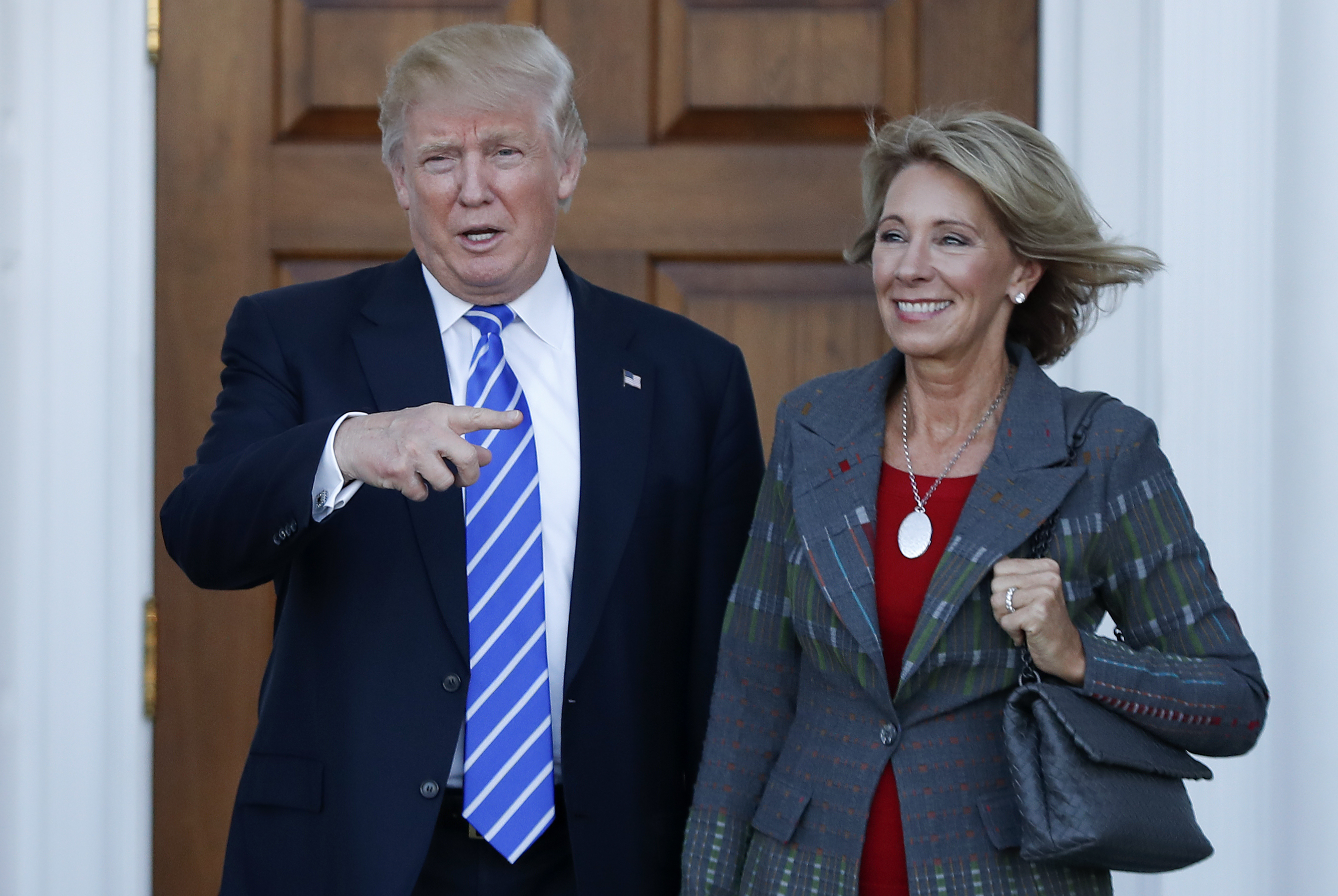 Photo: Donald Trump, Betsy DeVos (AP Photo)