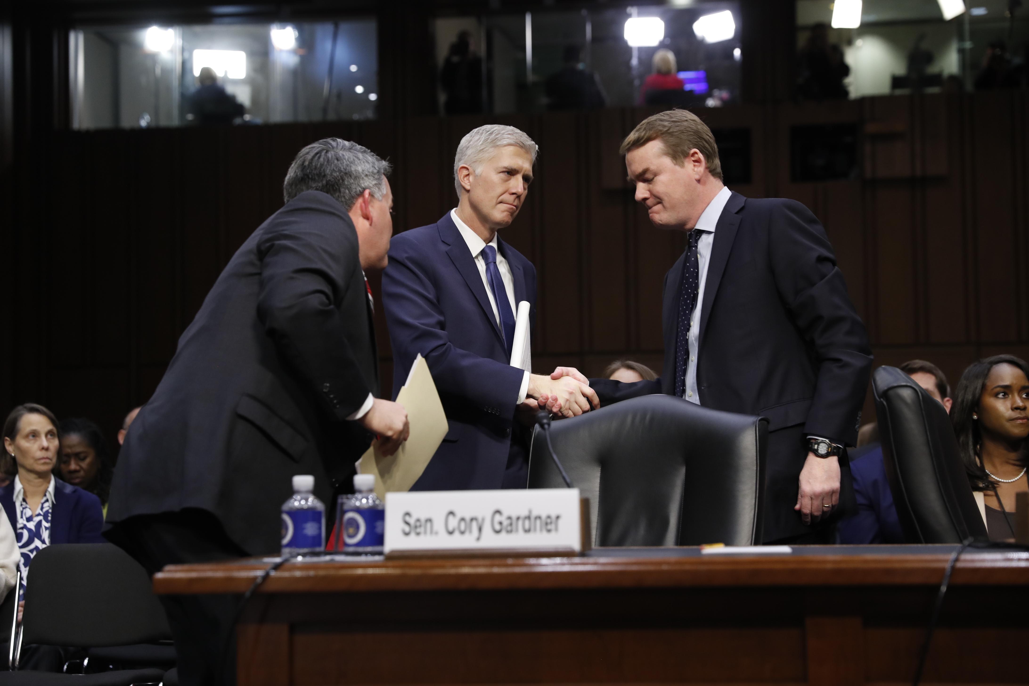 Photo: Gorsuch, Bennet (AP Photo)