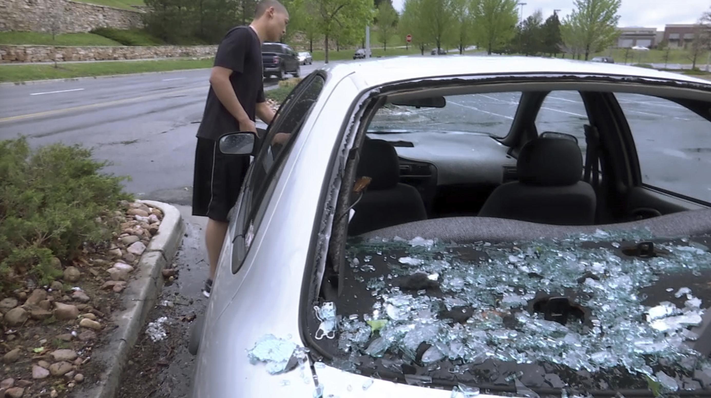 Photo: Car Hail Damage - AP Photo