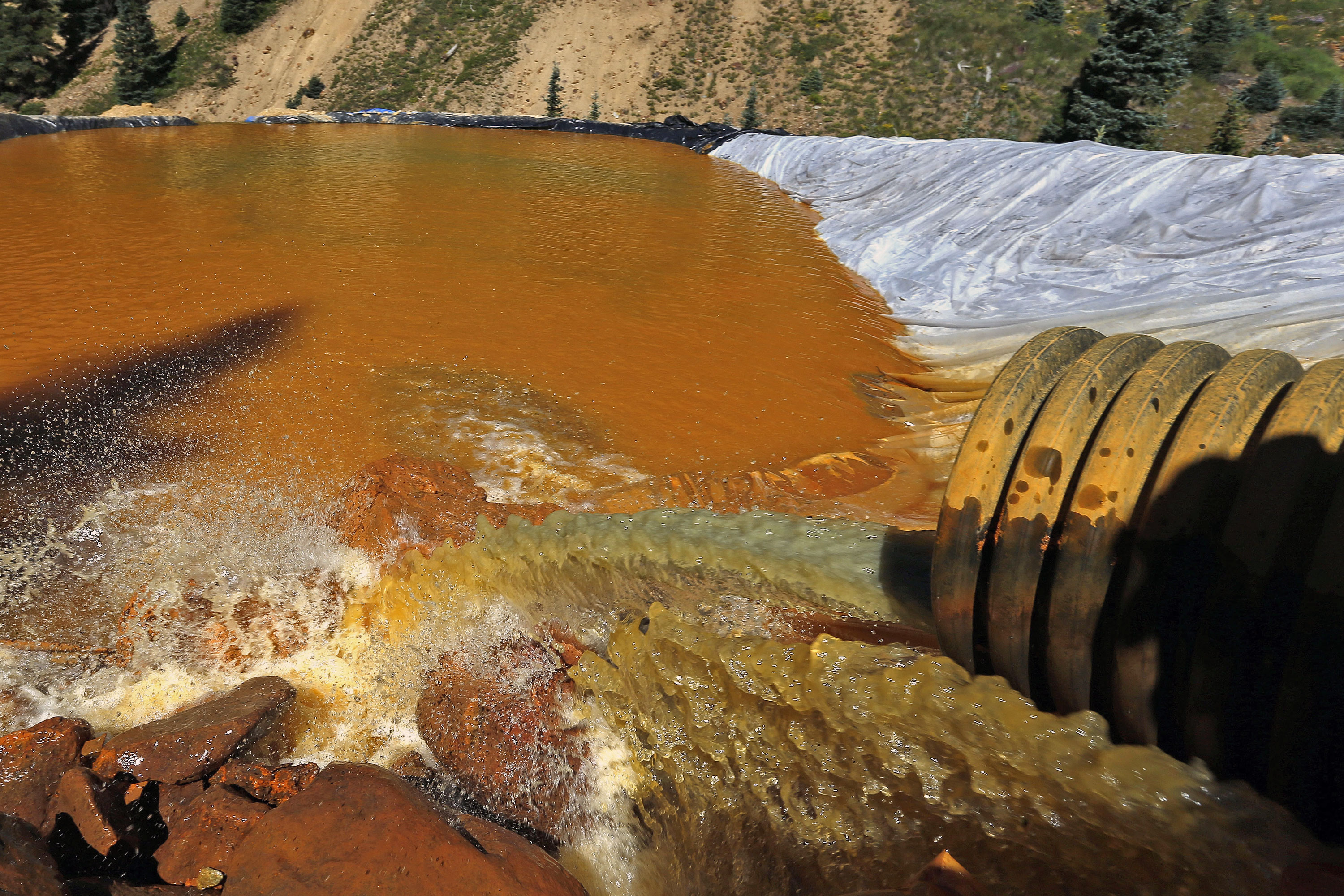Photo: Gold King Mine Spill | Water Retention Pond - AP Photo