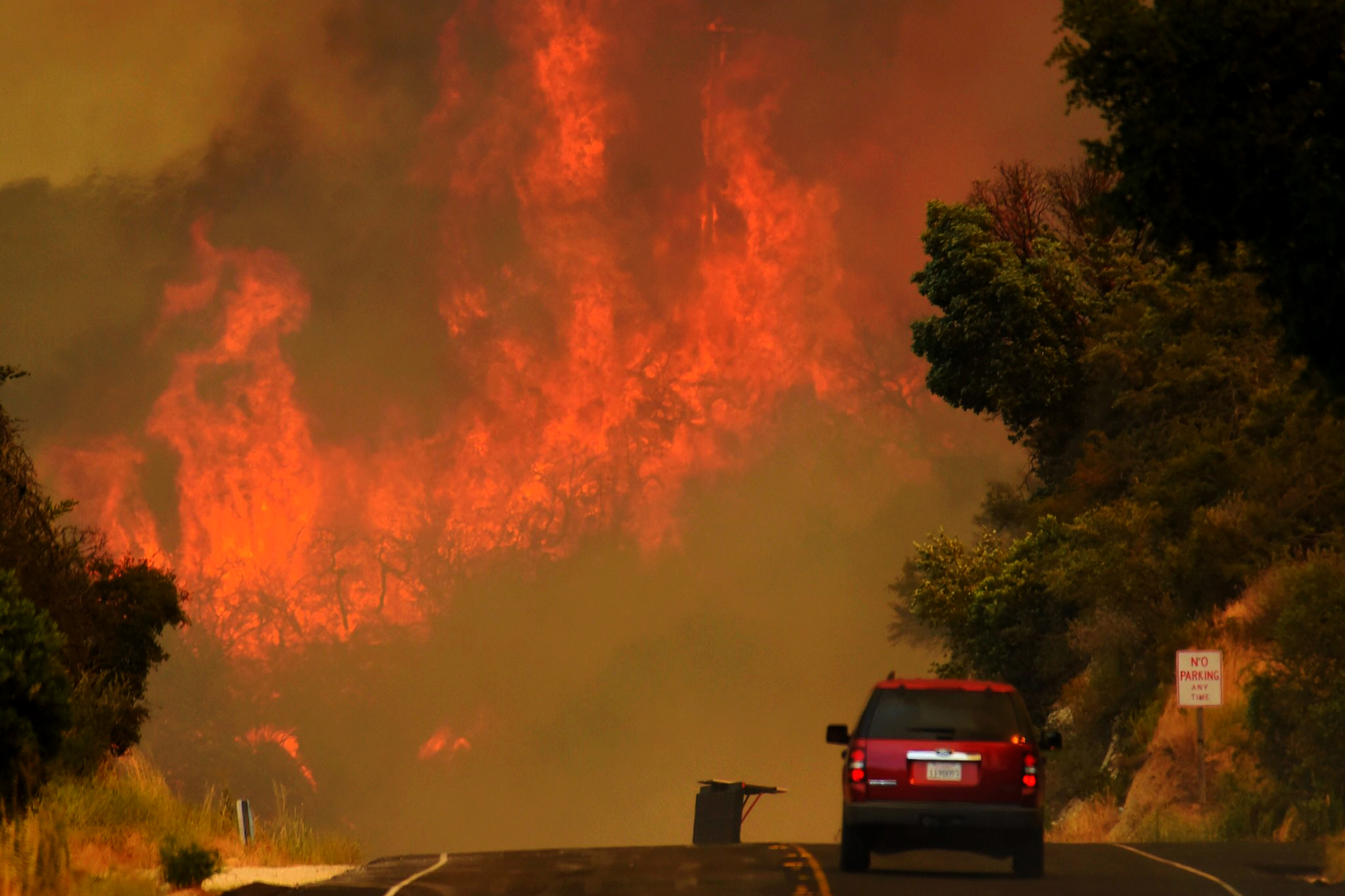 Photo: Western Wildfires Can On Road (AP)