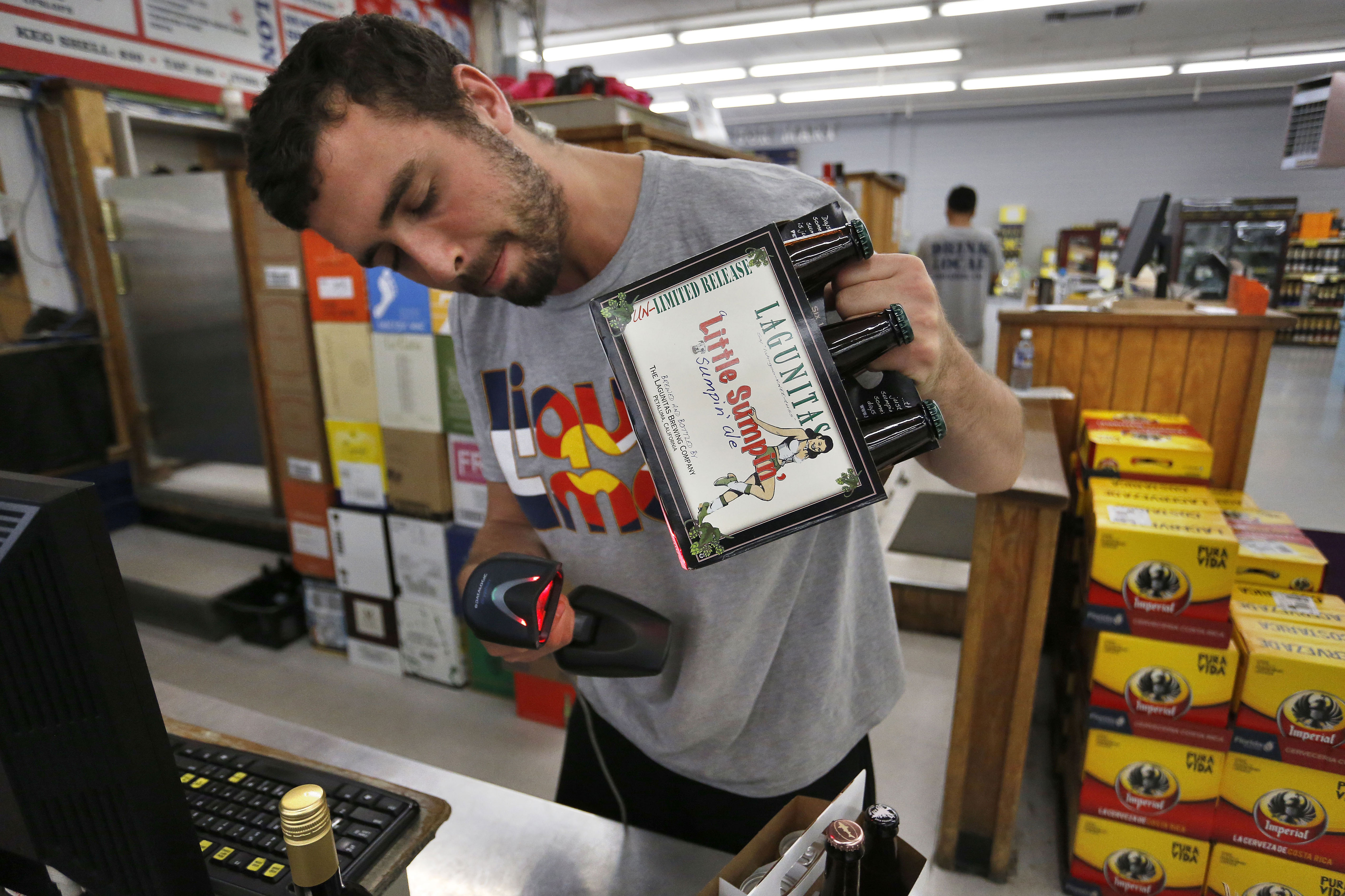 Photo: Colorado Beer Sales | Boulder Liqour Mart Cashier - AP