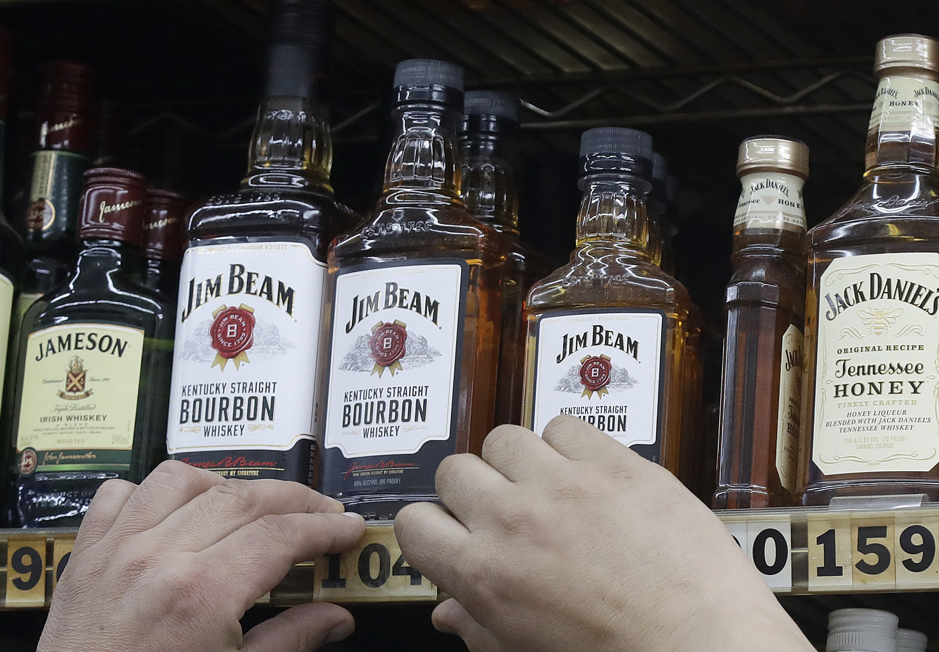 Photo: Whiskey Bottles - AP Photo