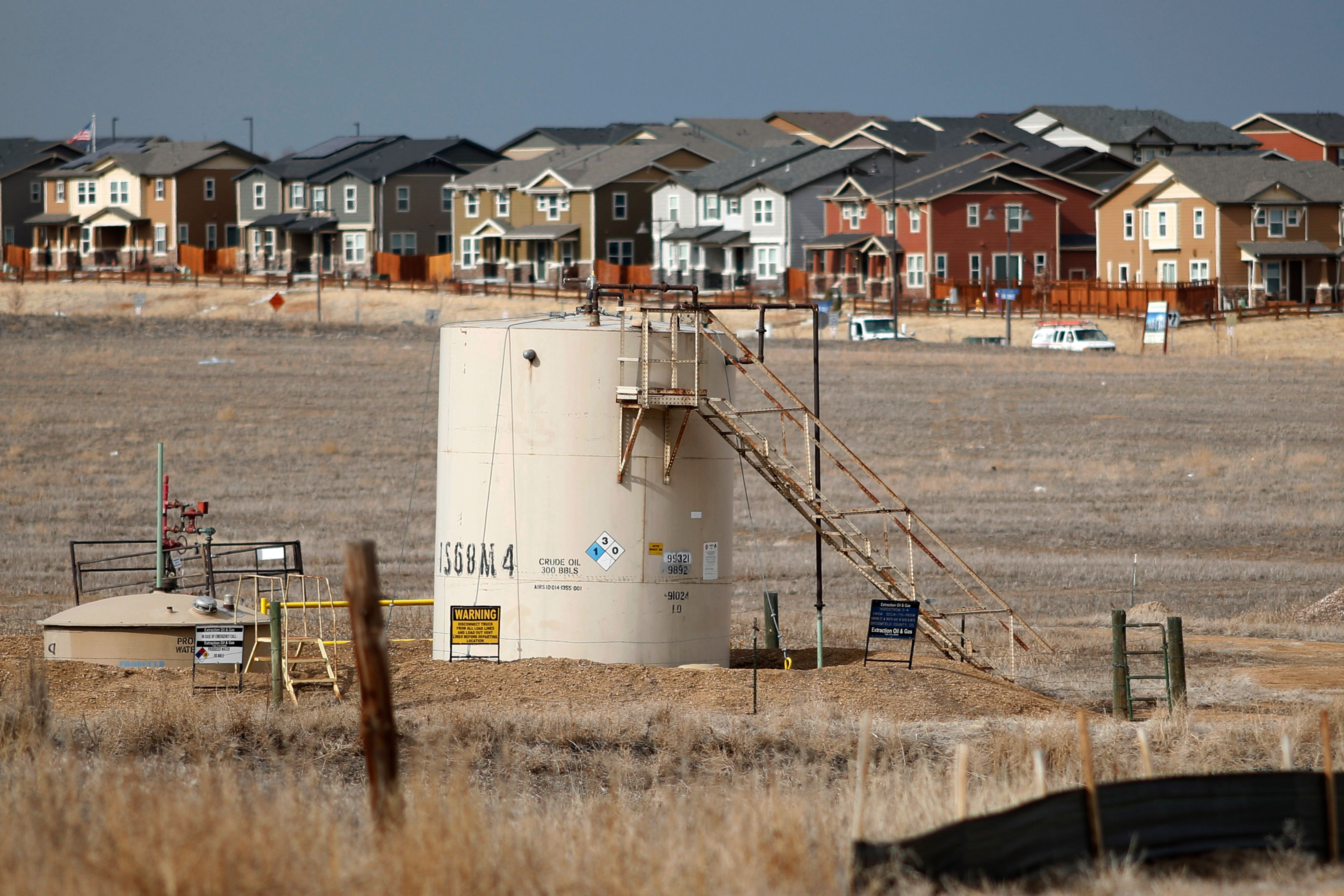 Photo: Broomfield Oil And Gas | Storage Tanks Near Houses - AP