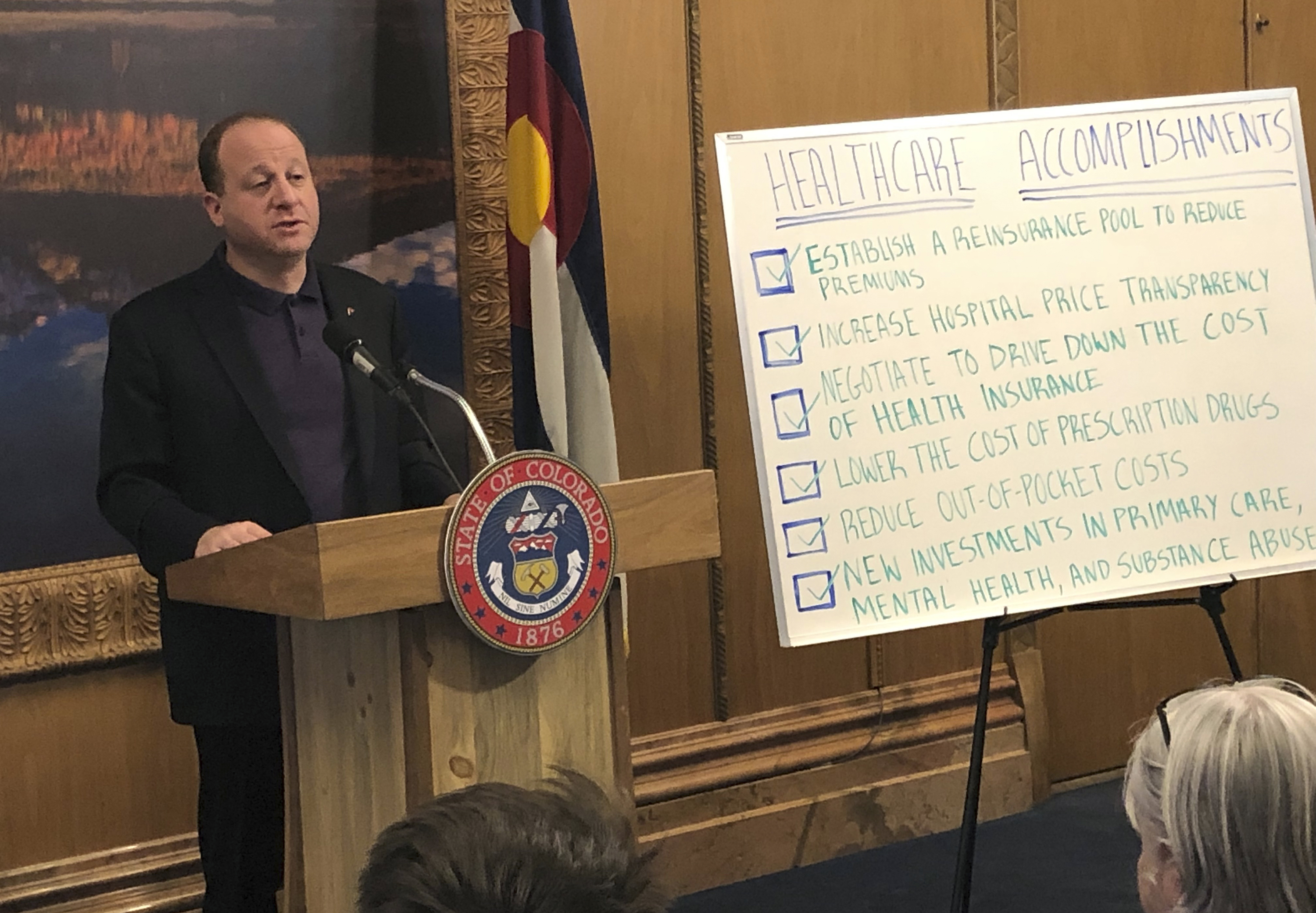 Colorado Gov. Jared Polis touts the Democrat-led legislature's accomplishments in tackling health care costs at a state Capitol briefing on Friday, May 3, 2019, in Denver.