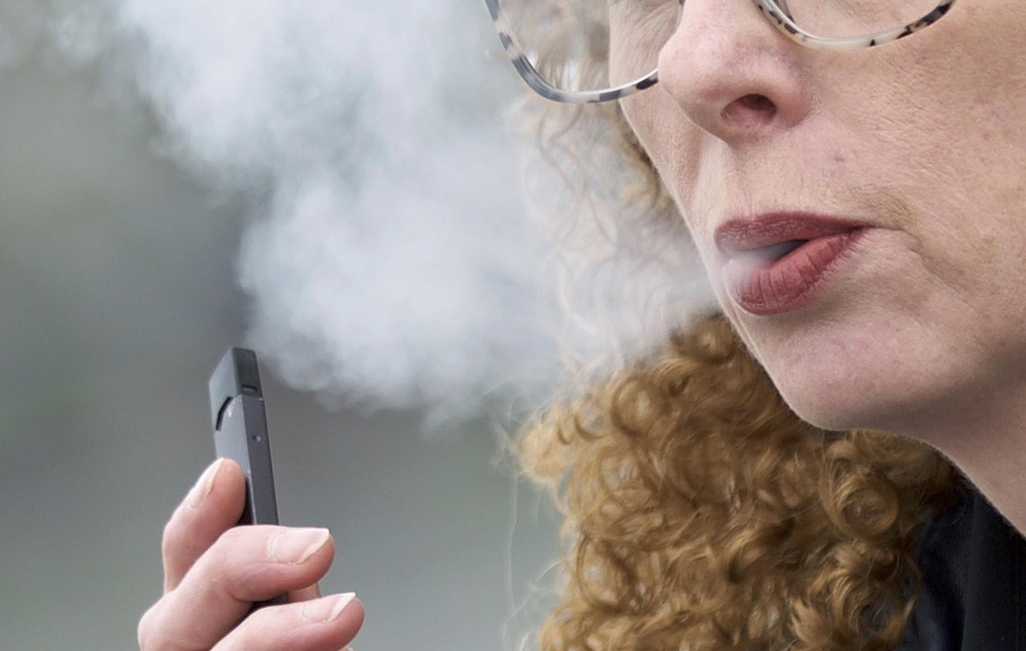 Photo: Vaping E-Cigs At Schools - AP photo