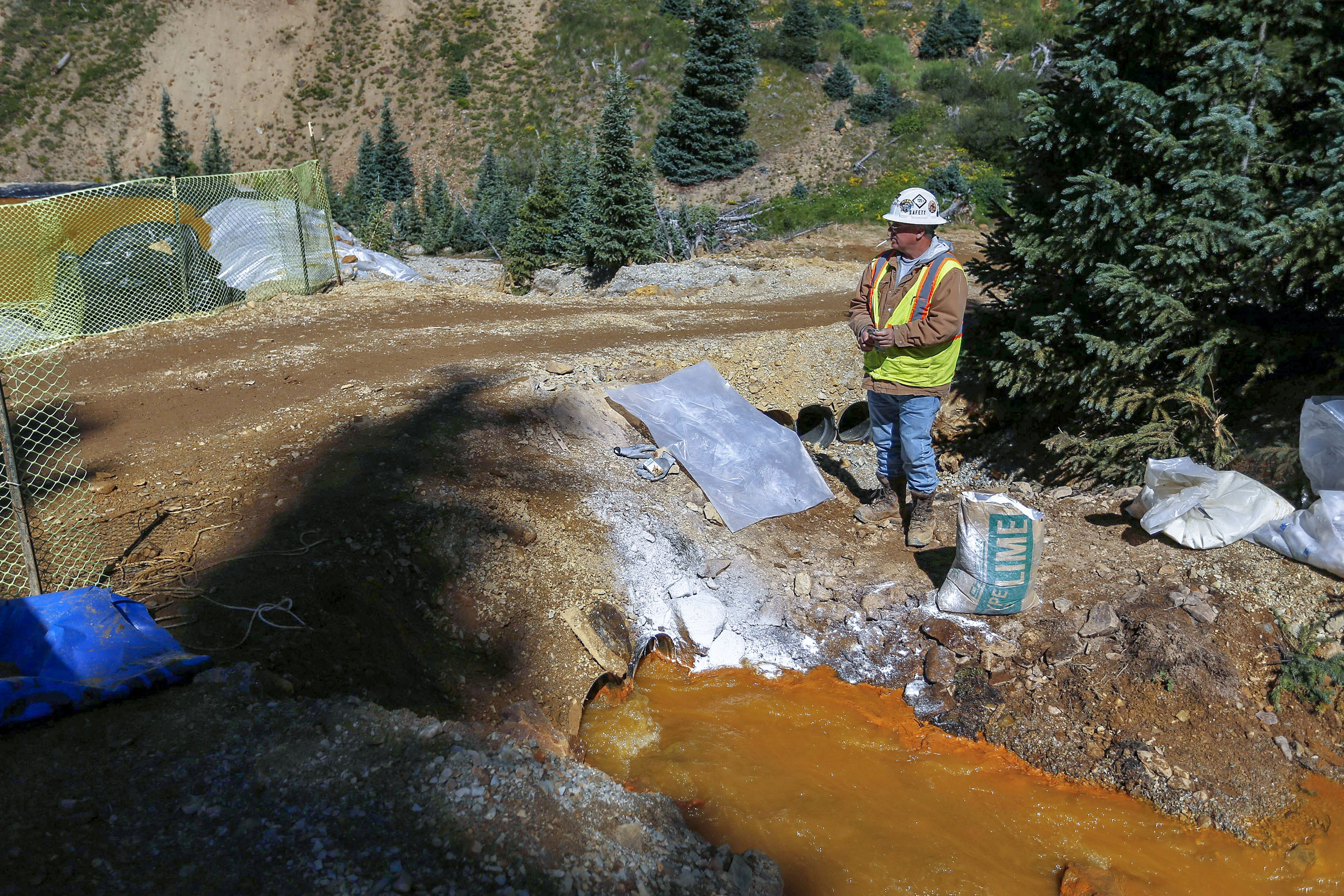 Photo: Gold King Mine Spill | EPA Worker With Water And Lime - AP