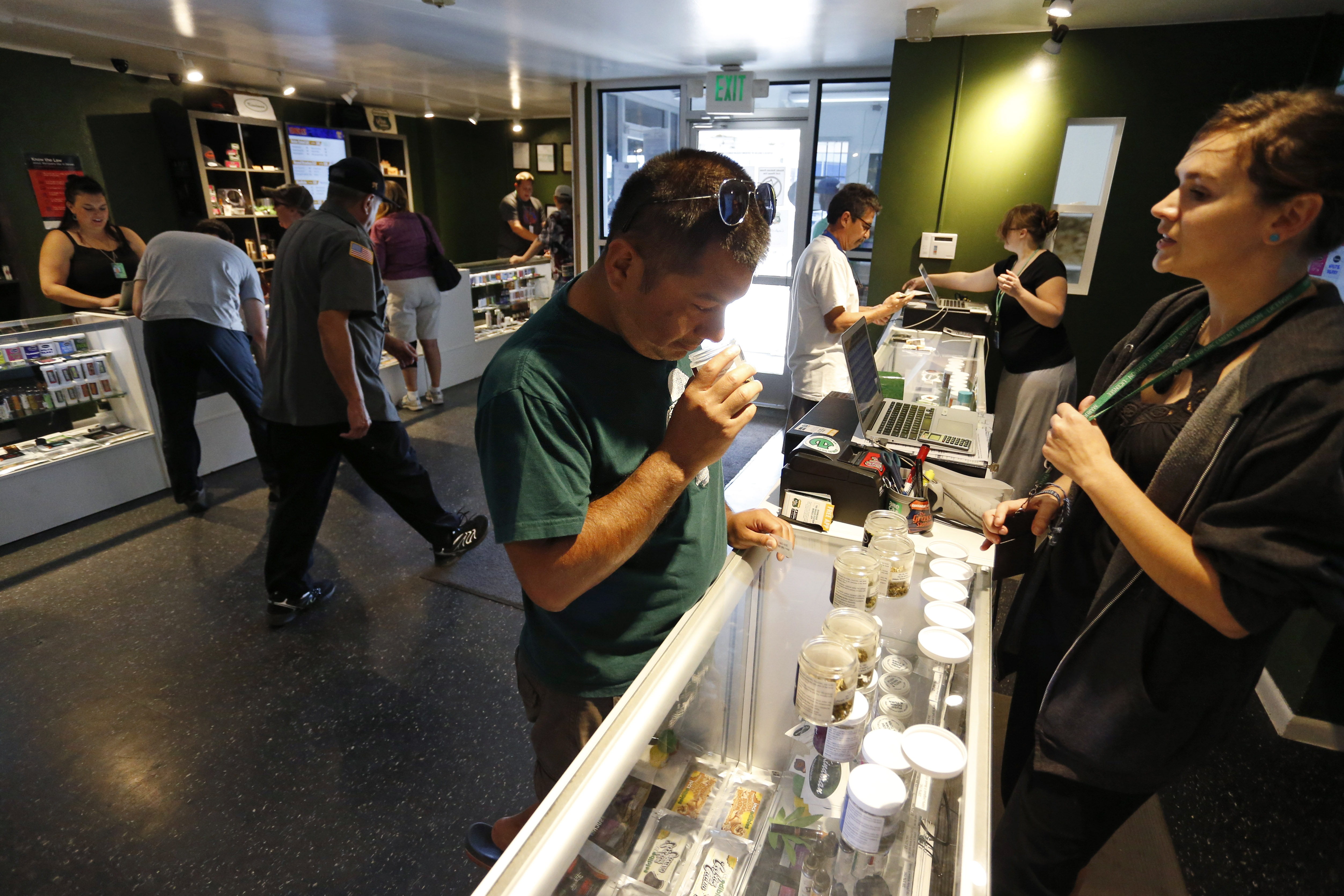 Photo: Customers buy recreational marijuana, September 2015 (AP Photo)