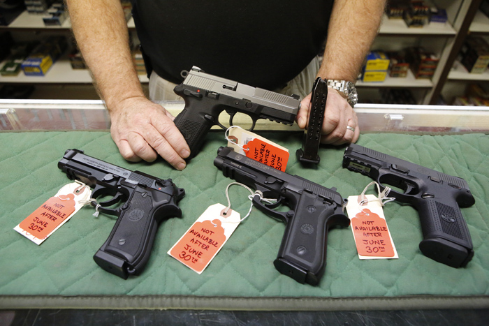 Photo: Guns for sale in Aurora (AP Photo)