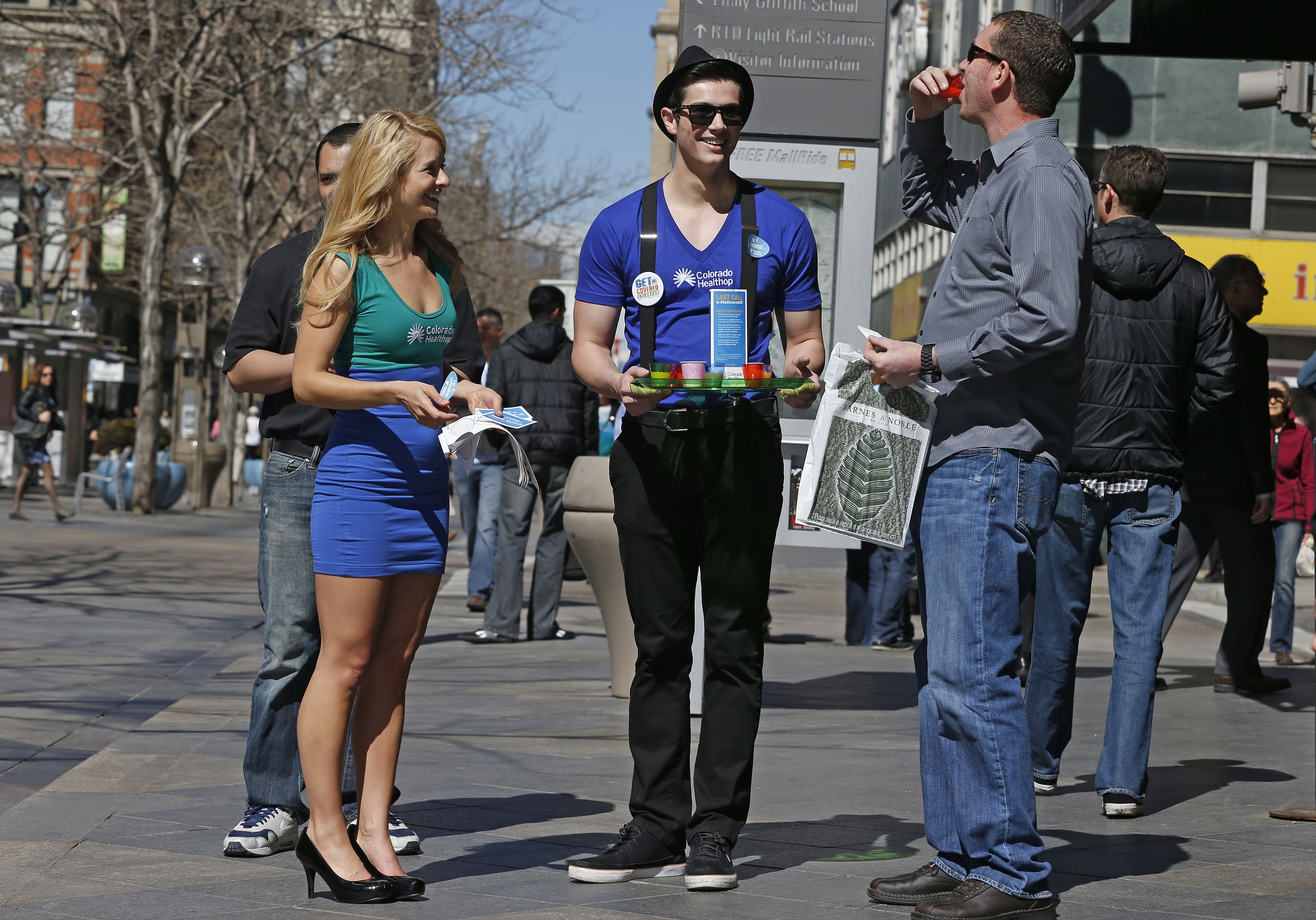 Photo: HealthOP workers hand out information (AP file)
