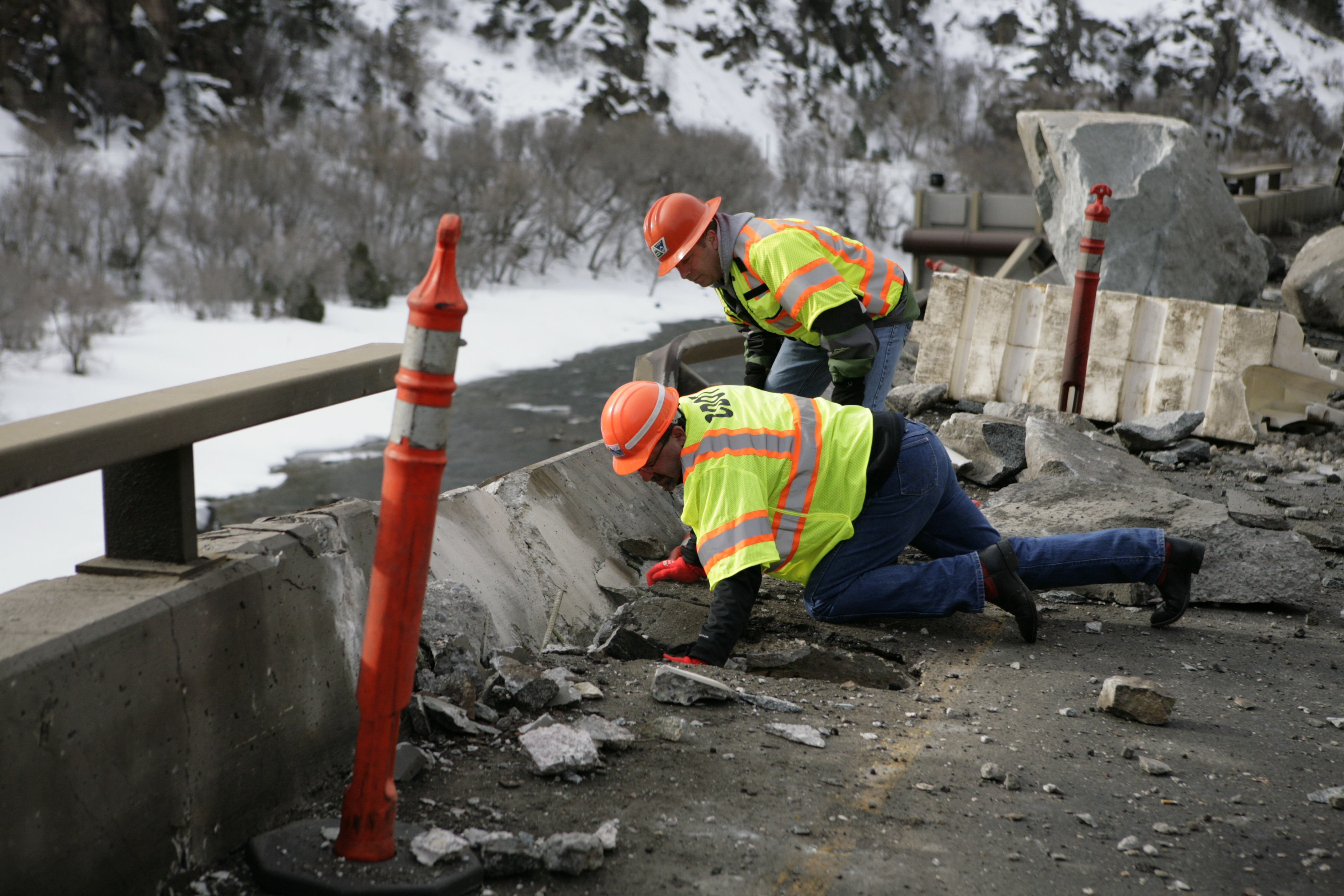 Photo: Workers inspect I-70 in Glenwood Canyon (AP Photo)