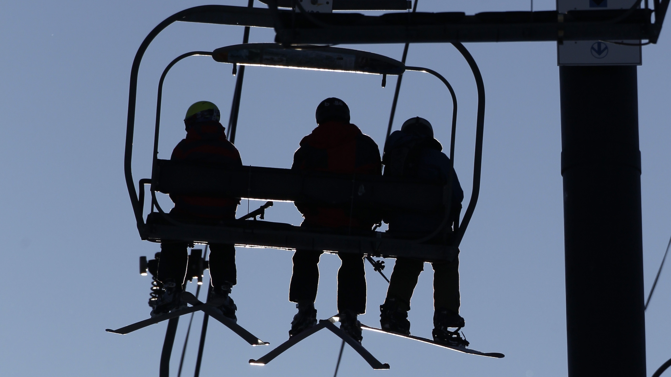 Photo: Skiers on lift (AP/file)