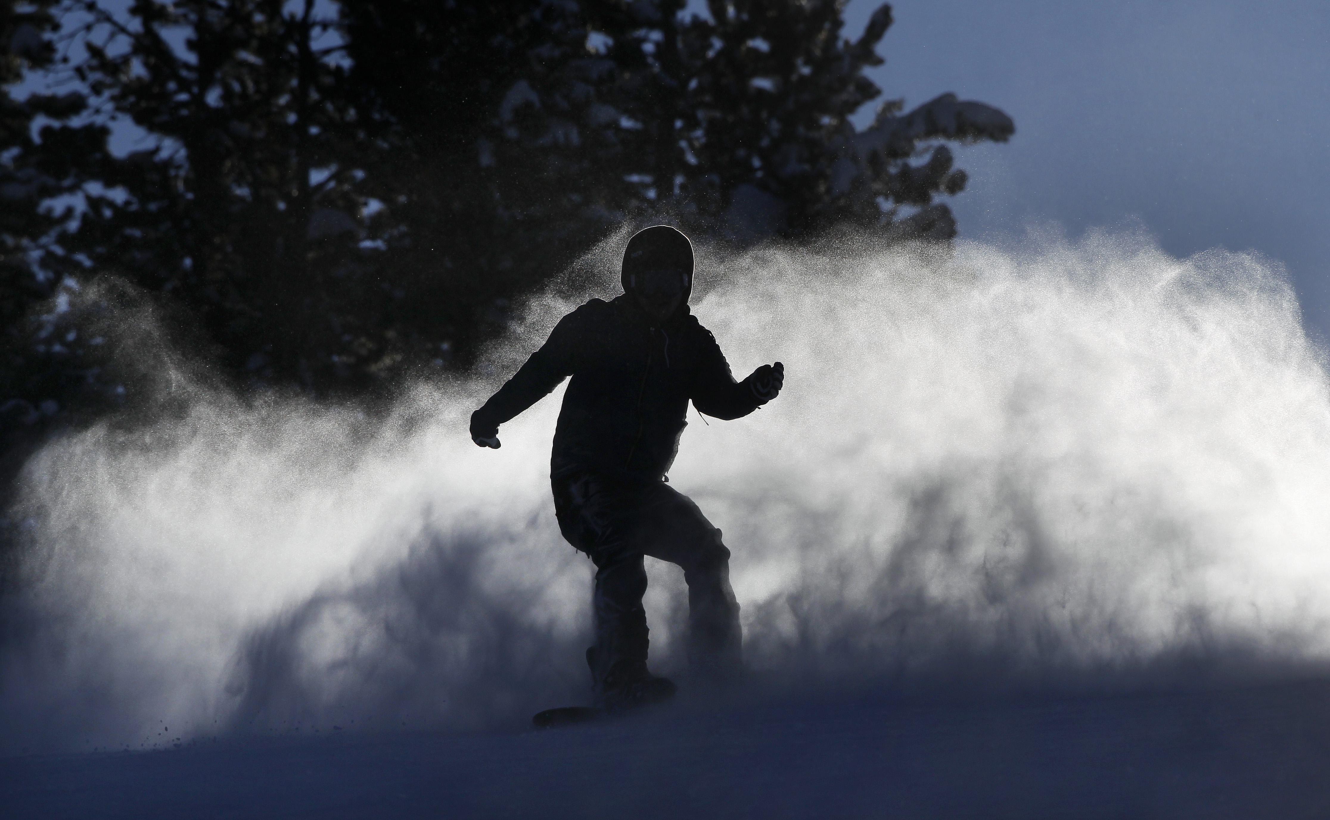 Photo: Snowboarder at Winter Park (AP Photo)