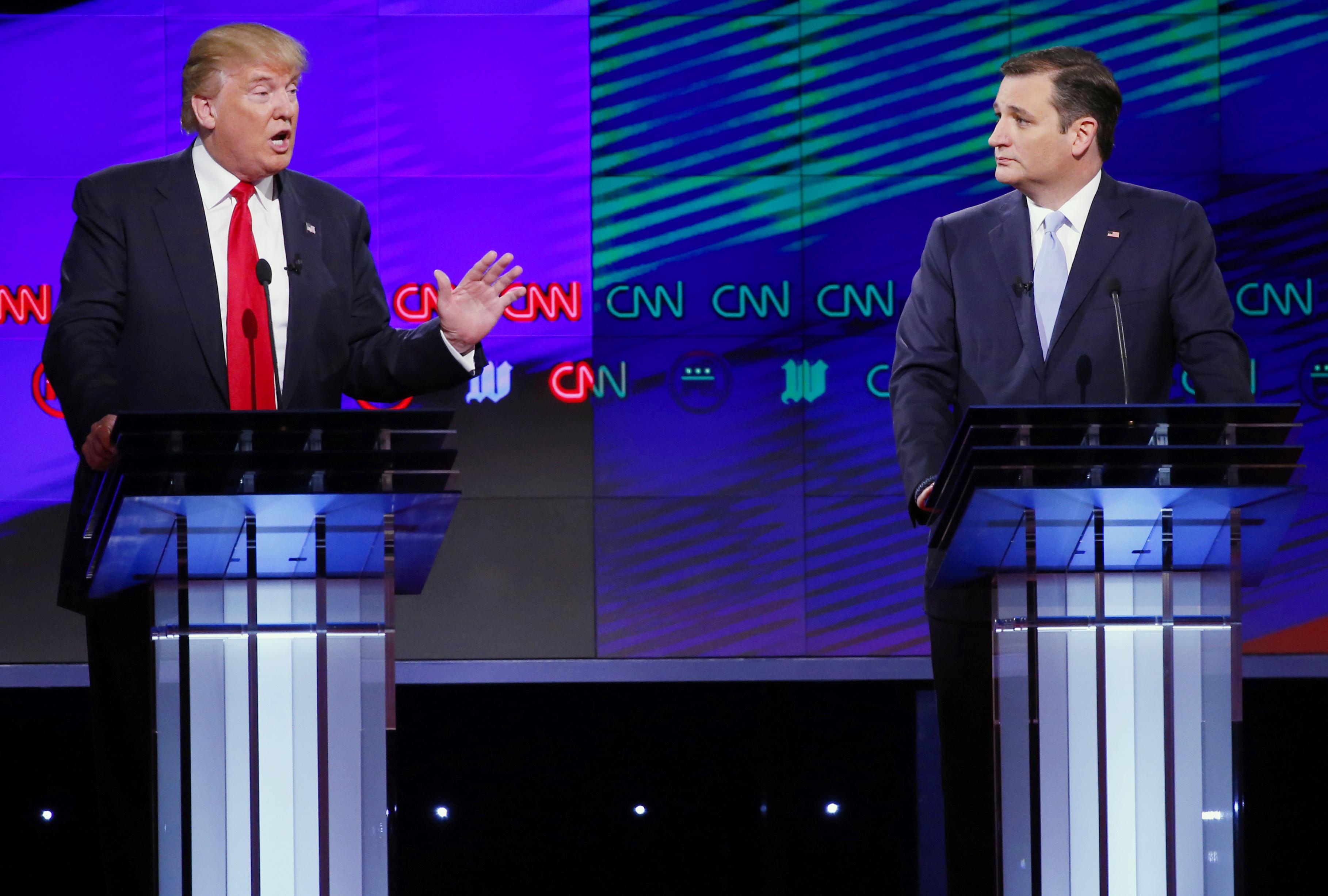 Photo: Trump, Cruz photos w/ delegate caption (AP Photo)