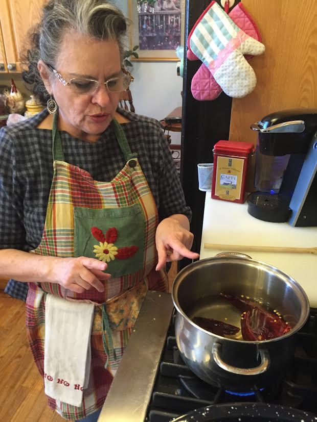 Photo: Becky Vasquez prepares tamales (Staff)