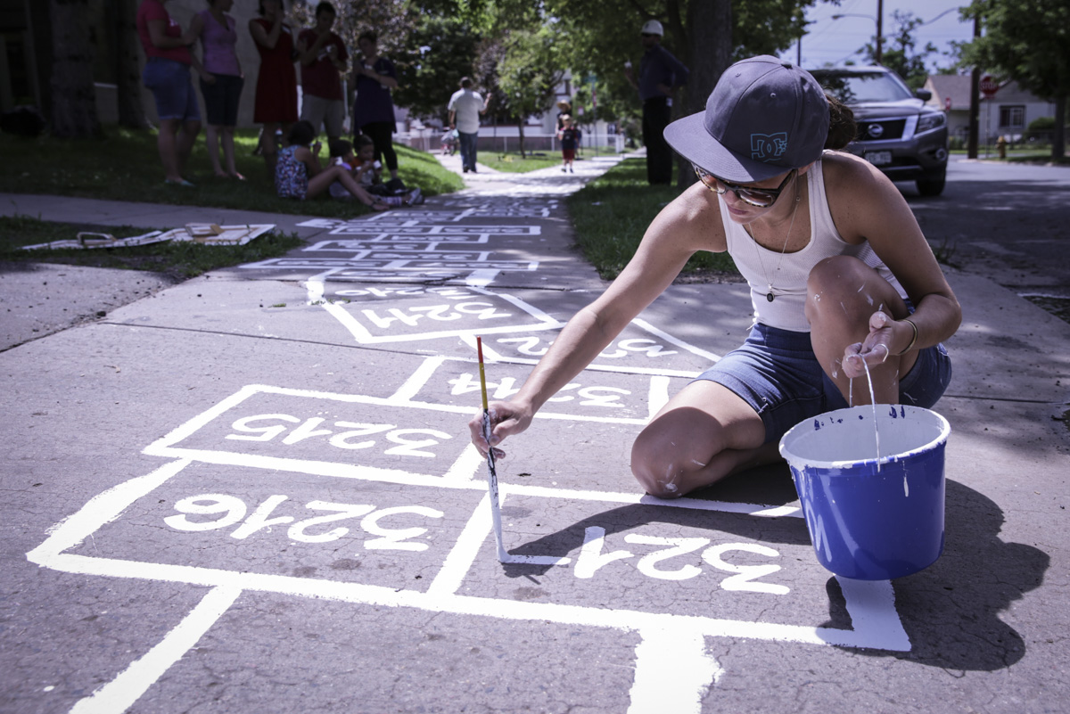 Photo: Agustina Woodgate paints Hopscotch at Biennial of the Americas