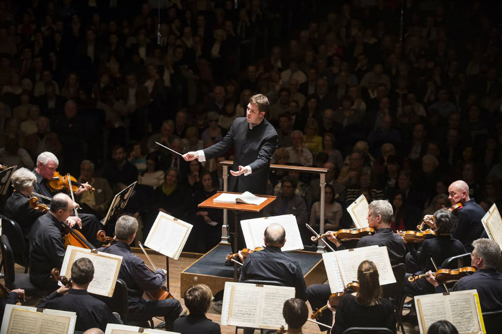 Photo: Brett Mitchell conducting Cleveland Orchestra