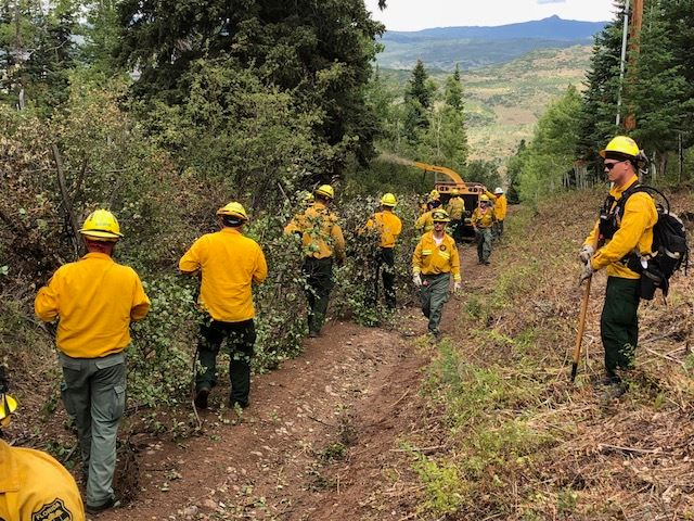 Photo: Cabin Lake Fire Workers Clear Debris 8-27