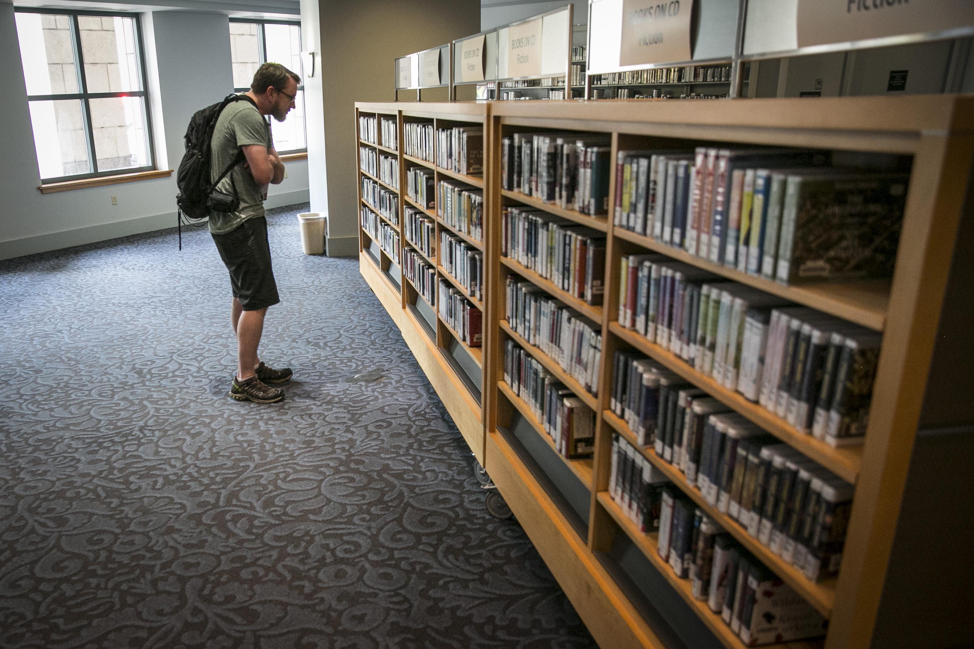 Photo: Denver Central Library 1   Perusing audio books