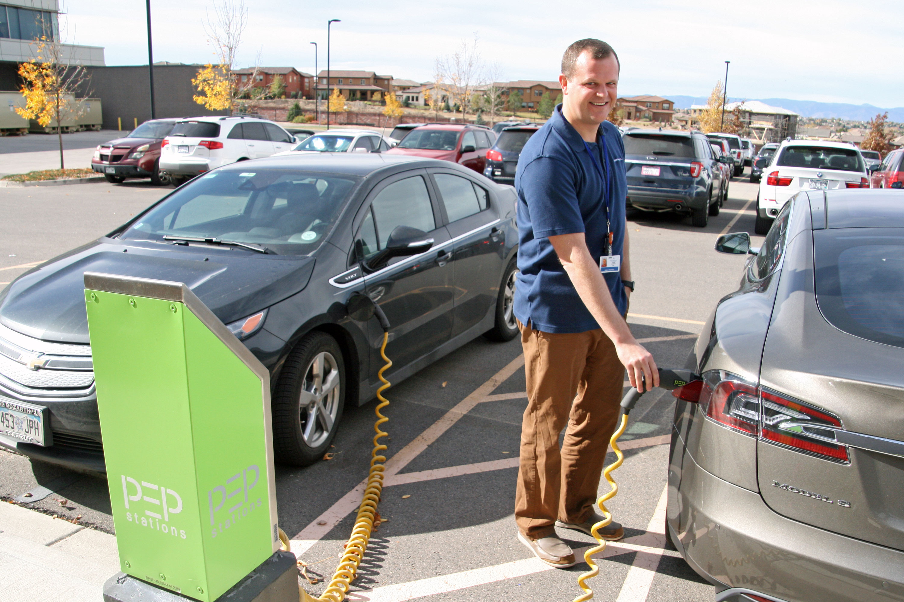 Family physician Dr. Adam Carewe takes advantage of a free charger station for his electric vehicle at Kaiser's Lone Tree office.
