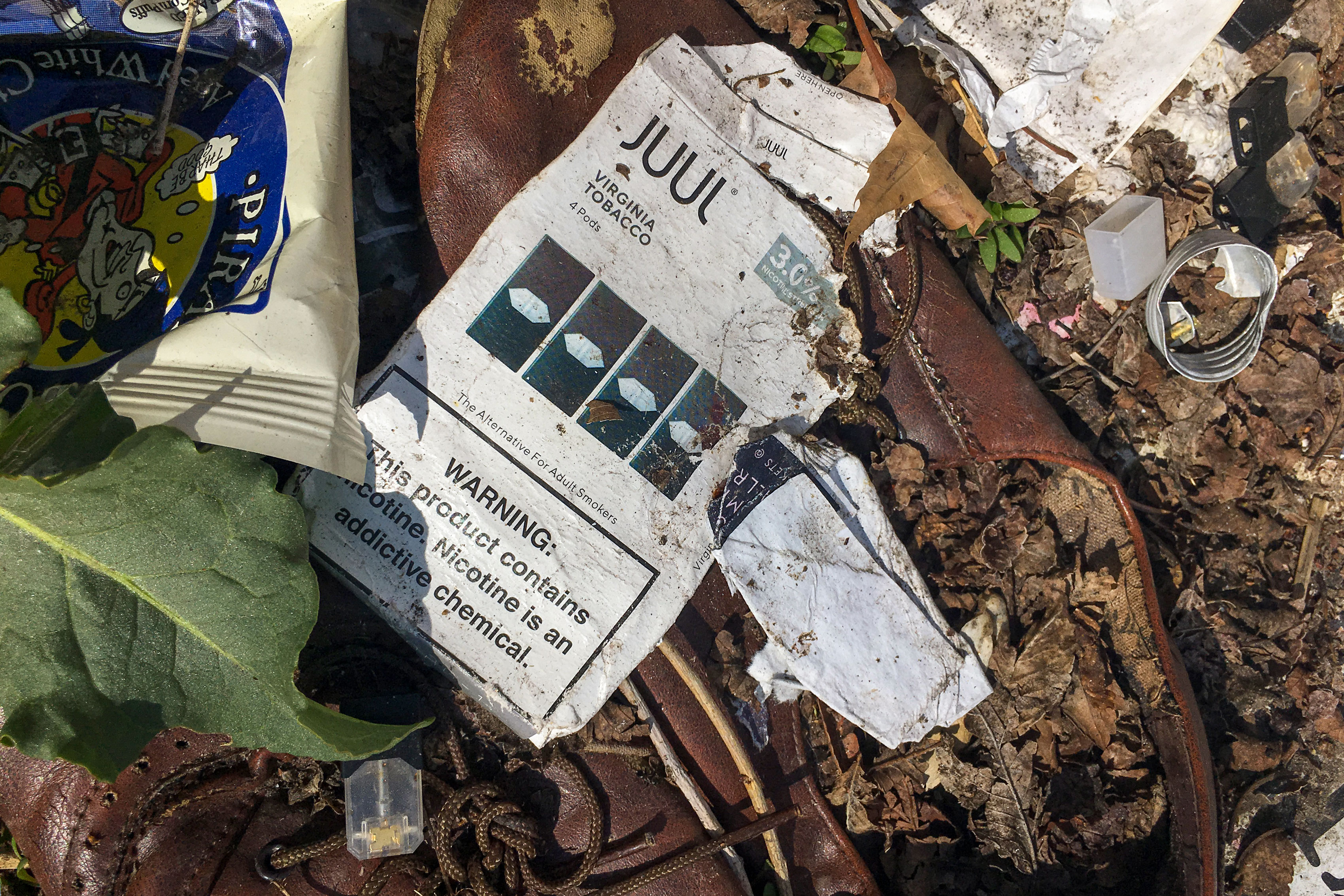 JUUL packages, devices and pods are easy to find tossed in the yards of homes near Boulder High.