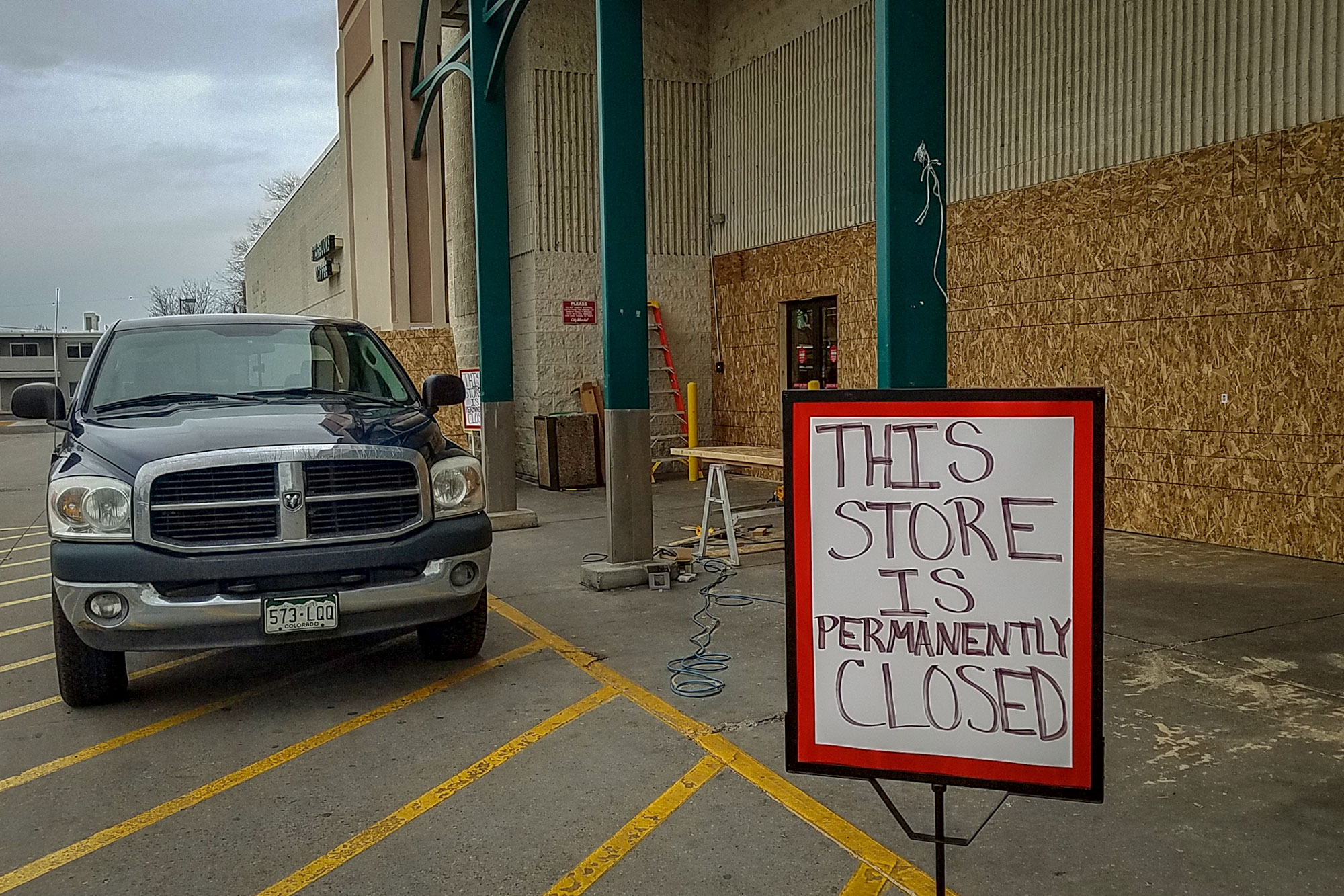 Photo: Downtown Grocery Closes 1 | Closed sign and work truck - RZastrow